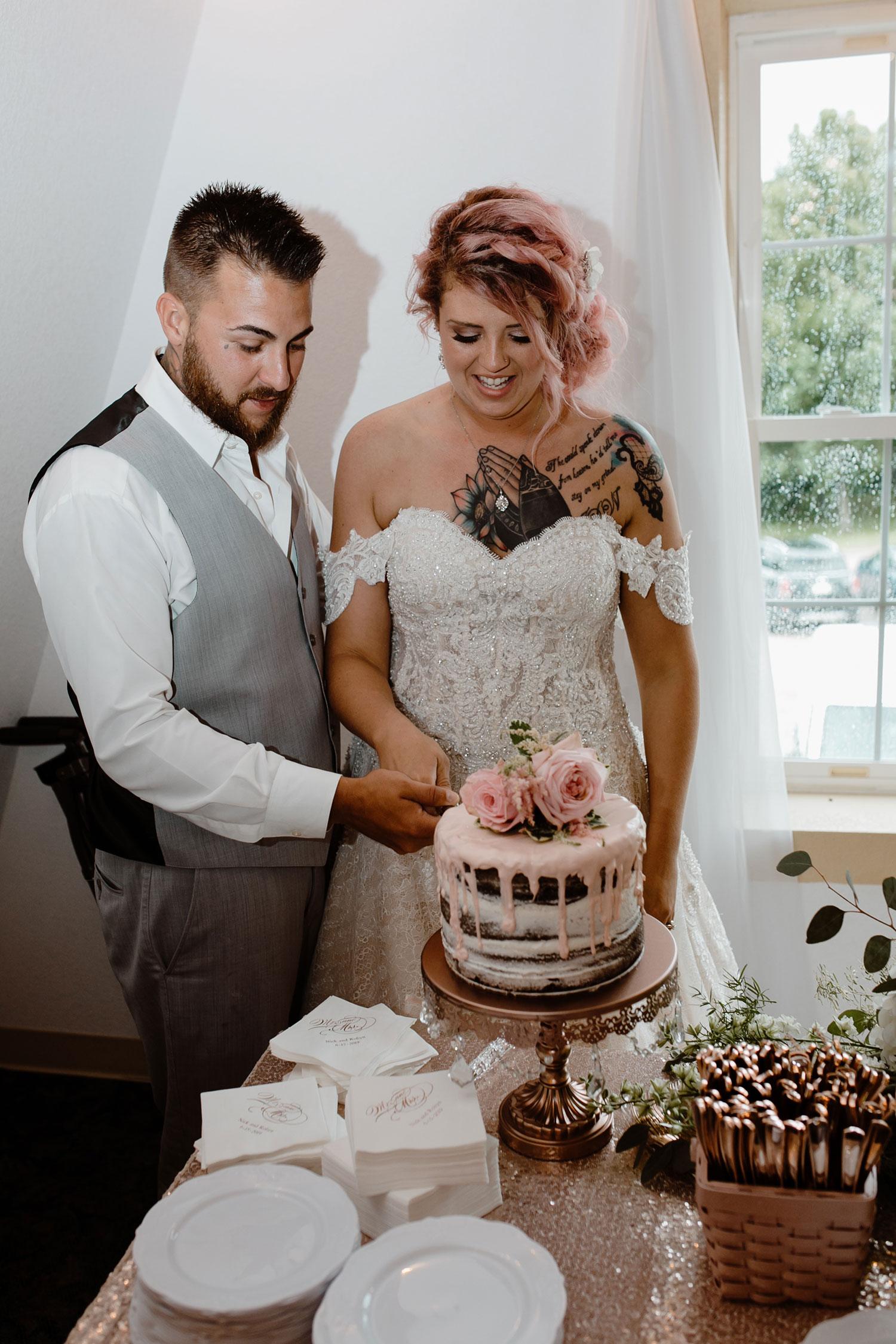 bride-groom-cutting-cake-wedding-summerset-winery-indianola-iowa-raelyn-ramey-photography.jpg