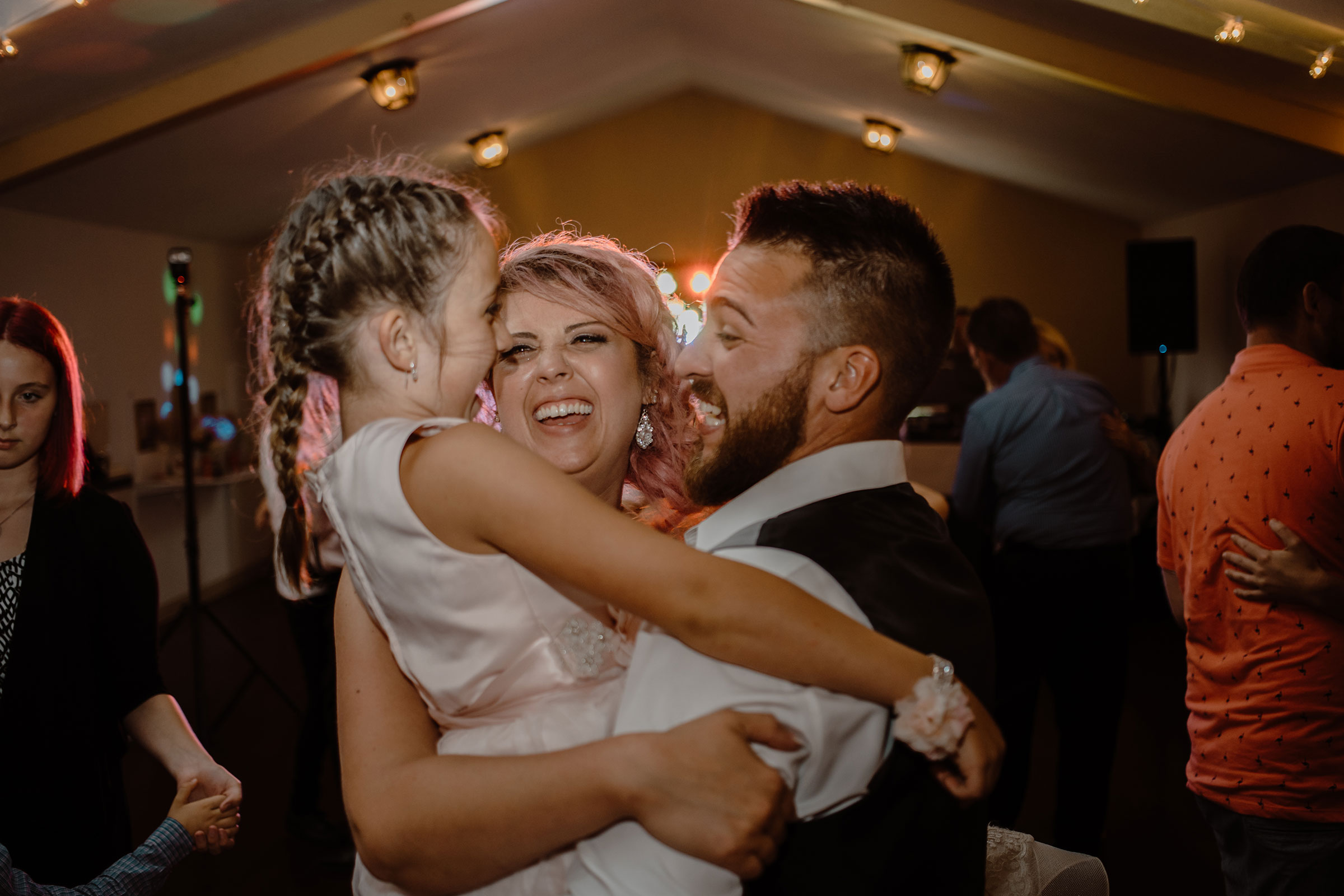 bride-groom-dancing-with-daughter-while-laughing-wedding-summerset-winery-indianola-iowa-raelyn-ramey-photography.jpg