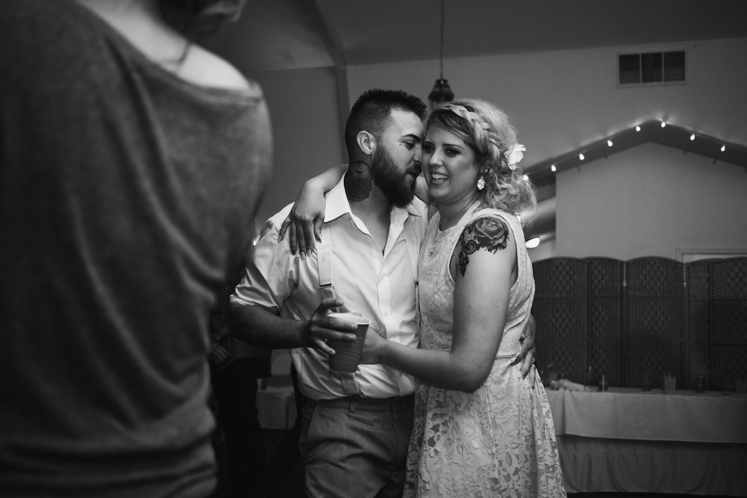 bride-groom-end-of-night-dancing-wedding-summerset-winery-indianola-iowa-raelyn-ramey-photography.jpg