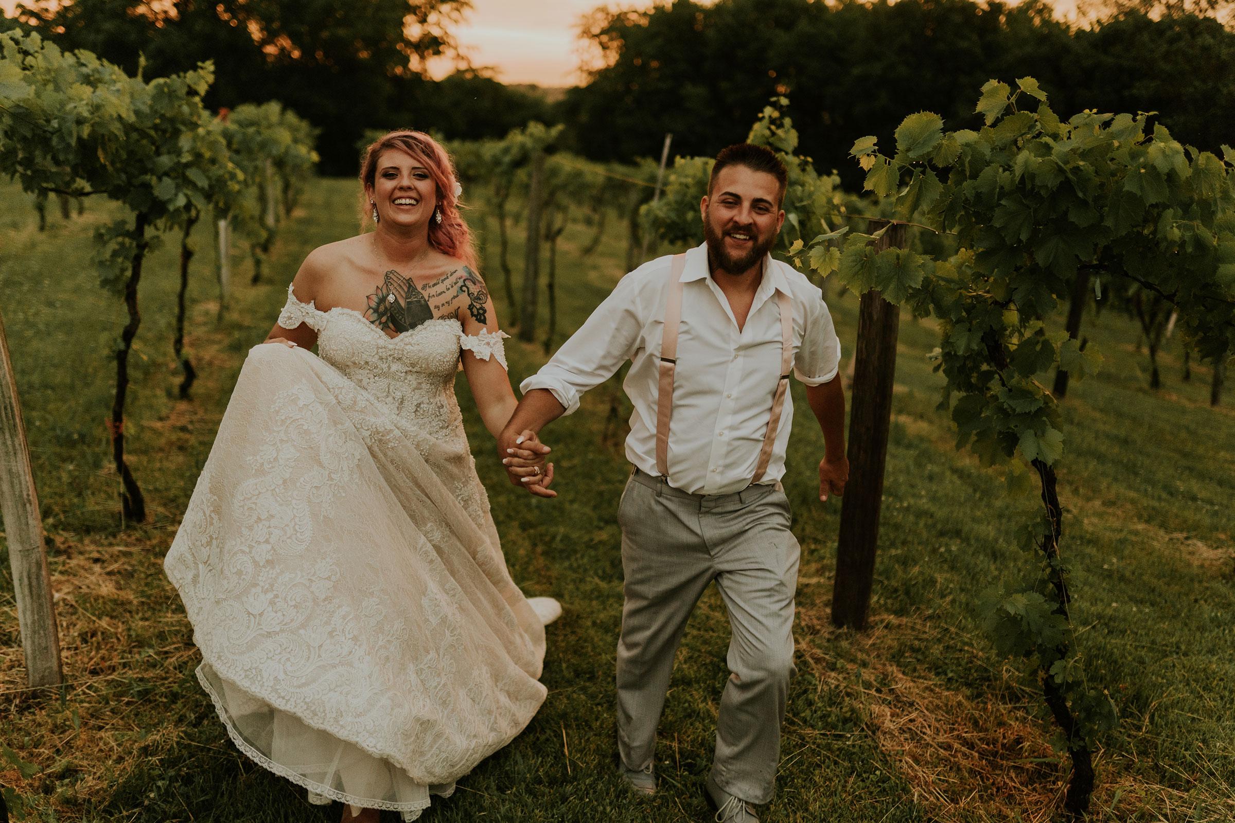 bride-groom-running-at-sunset-in-vineyard-wedding-summerset-winery-indianola-iowa-raelyn-ramey-photography.jpg