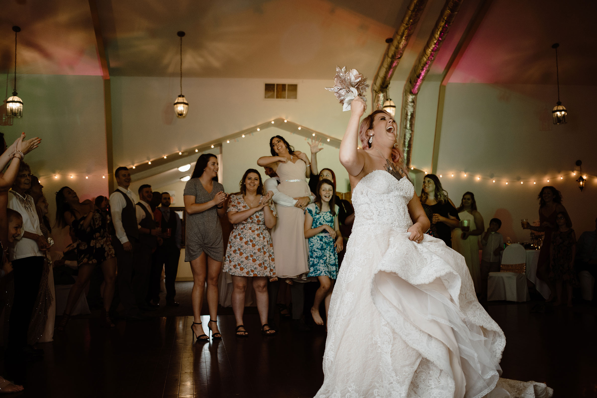 bride-laughing-at-fake-bouquet-toss-wedding-summerset-winery-indianola-iowa-raelyn-ramey-photography.jpg