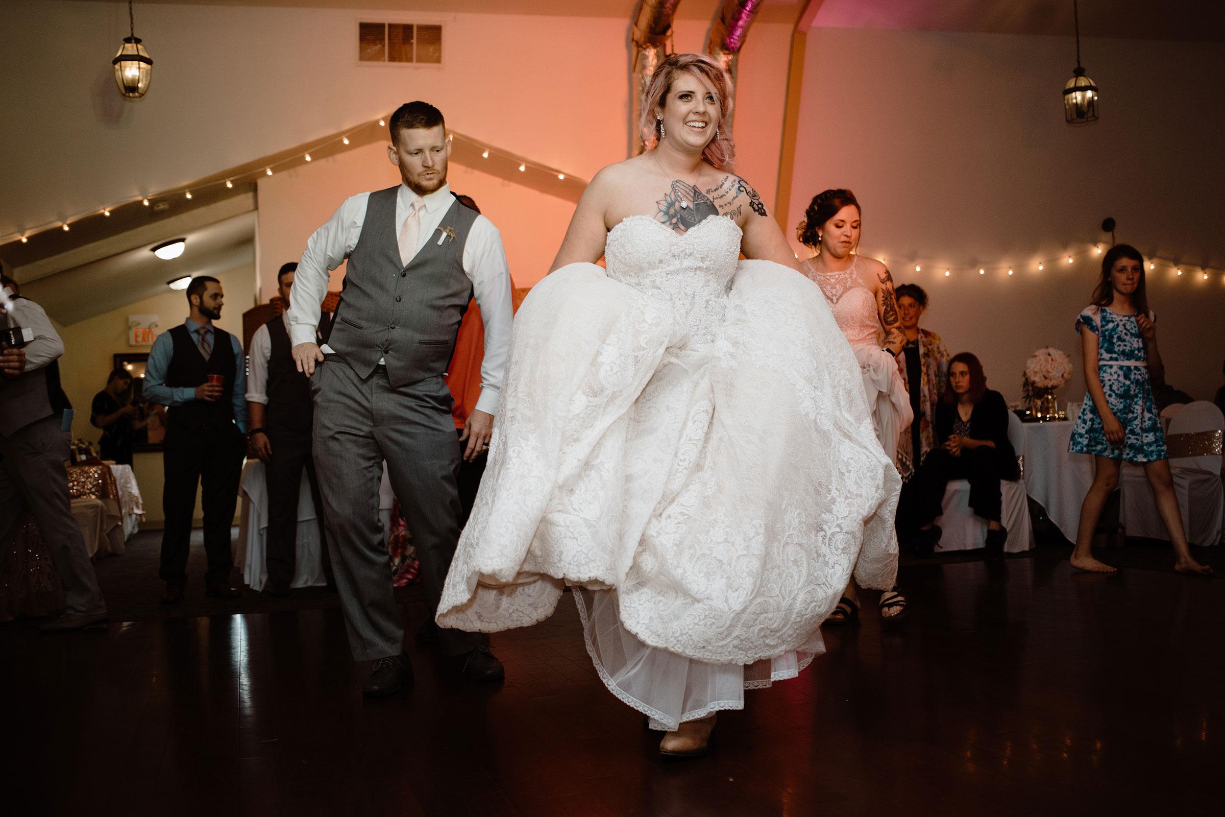 bride-line-dancing-wedding-summerset-winery-indianola-iowa-raelyn-ramey-photography.jpg