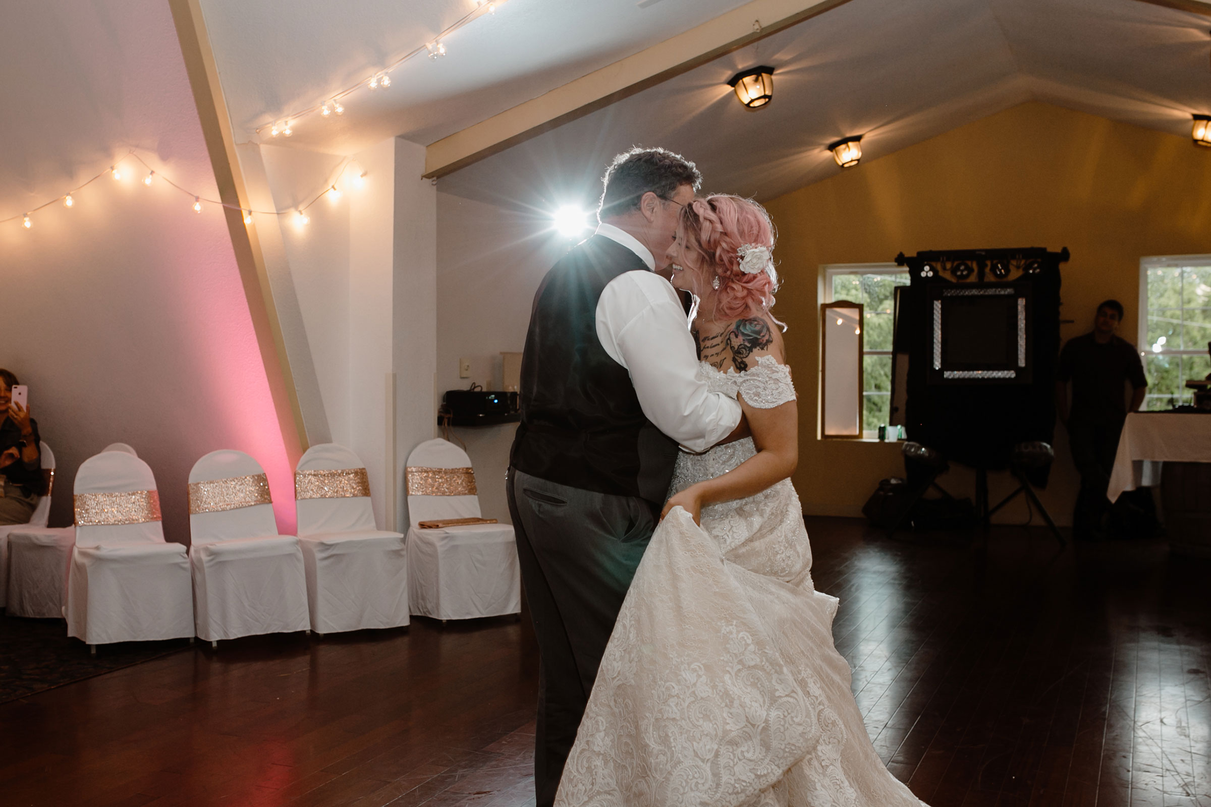 bride-smiling-while-dancing-with-father-wedding-summerset-winery-indianola-iowa-raelyn-ramey-photography.jpg