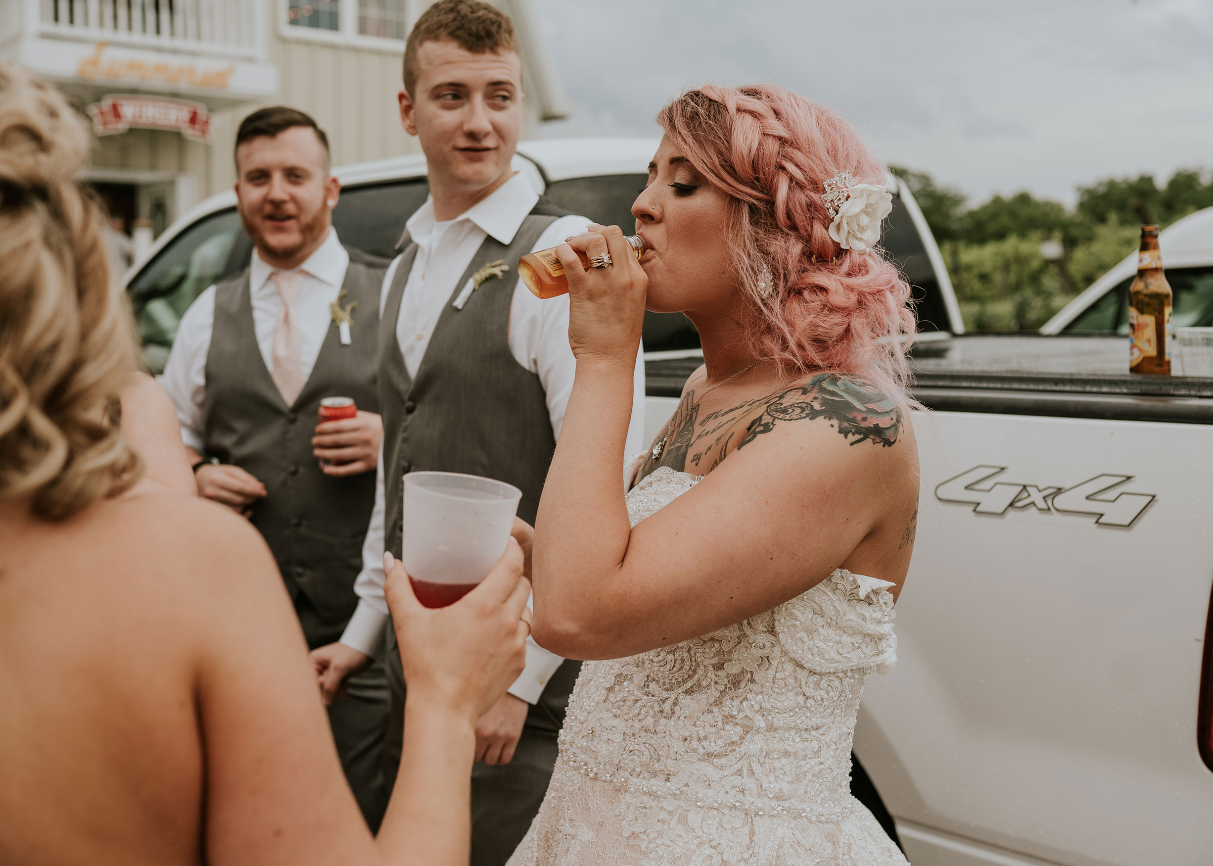 bride-taking-shots-with-brothers-wedding-summerset-winery-indianola-iowa-raelyn-ramey-photography.jpg