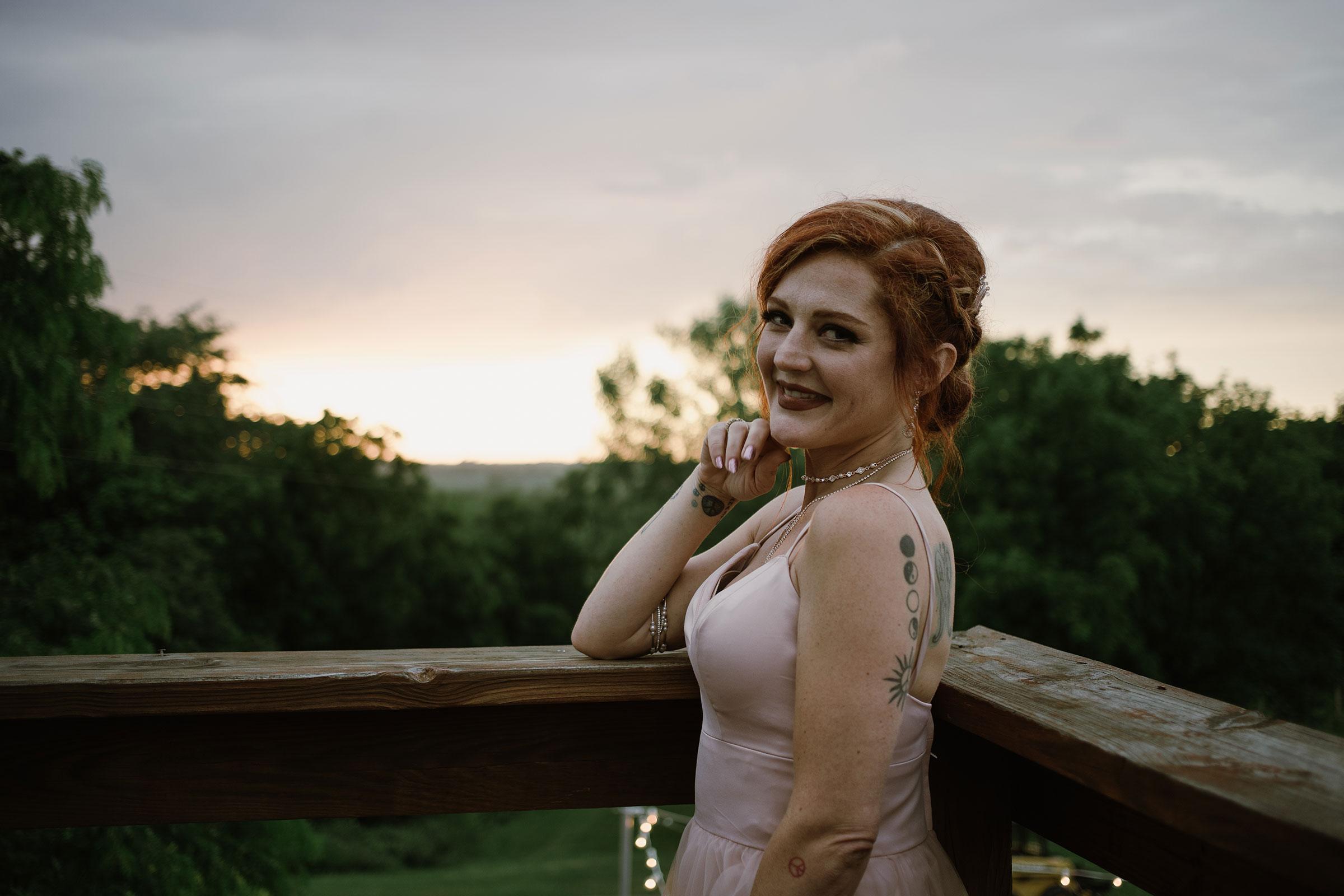 bridesmaid-posing-outside-with-sunset-wedding-summerset-winery-indianola-iowa-raelyn-ramey-photography.jpg