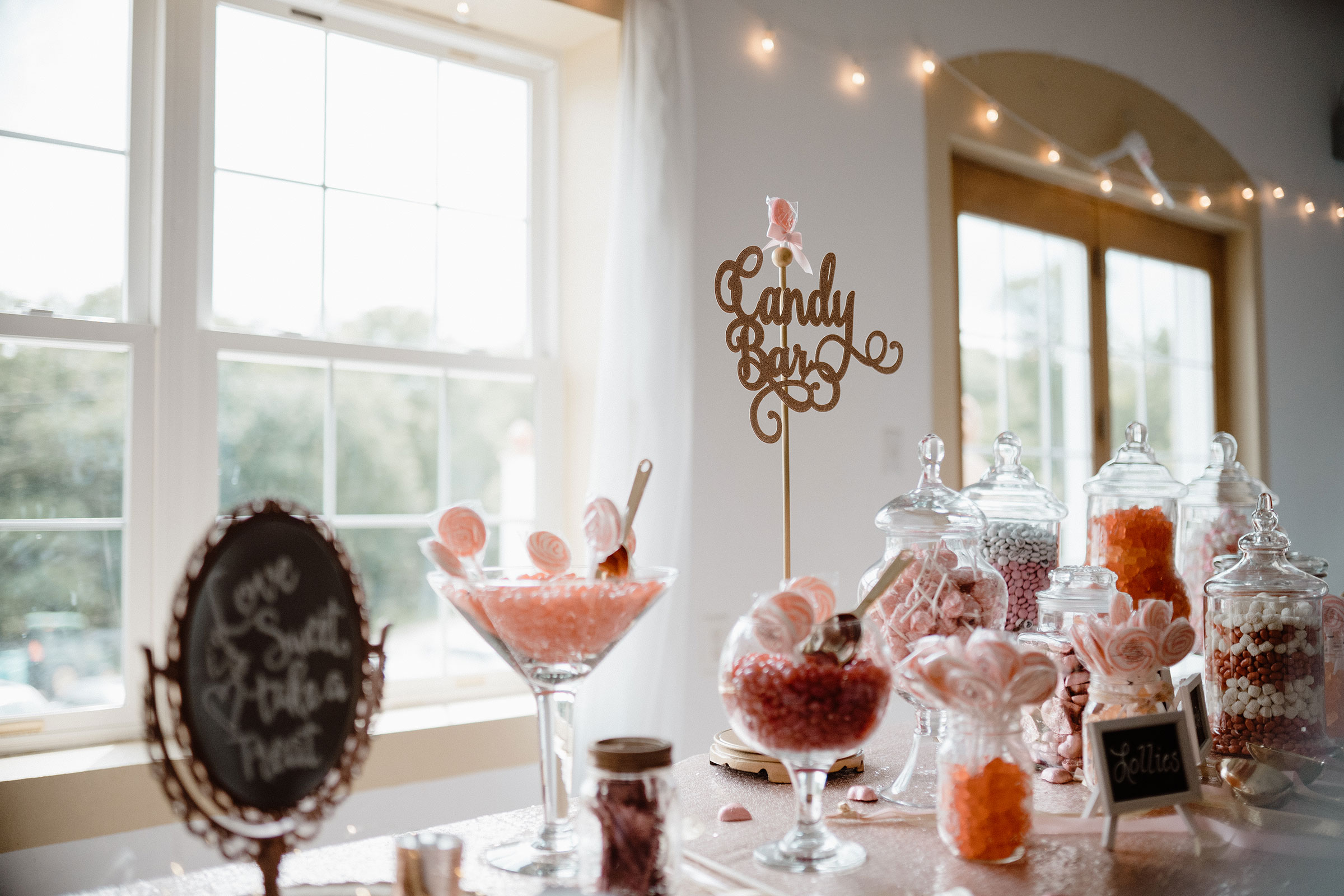 candy-bar--sign-wedding-summerset-winery-indianola-iowa-raelyn-ramey-photography.jpg