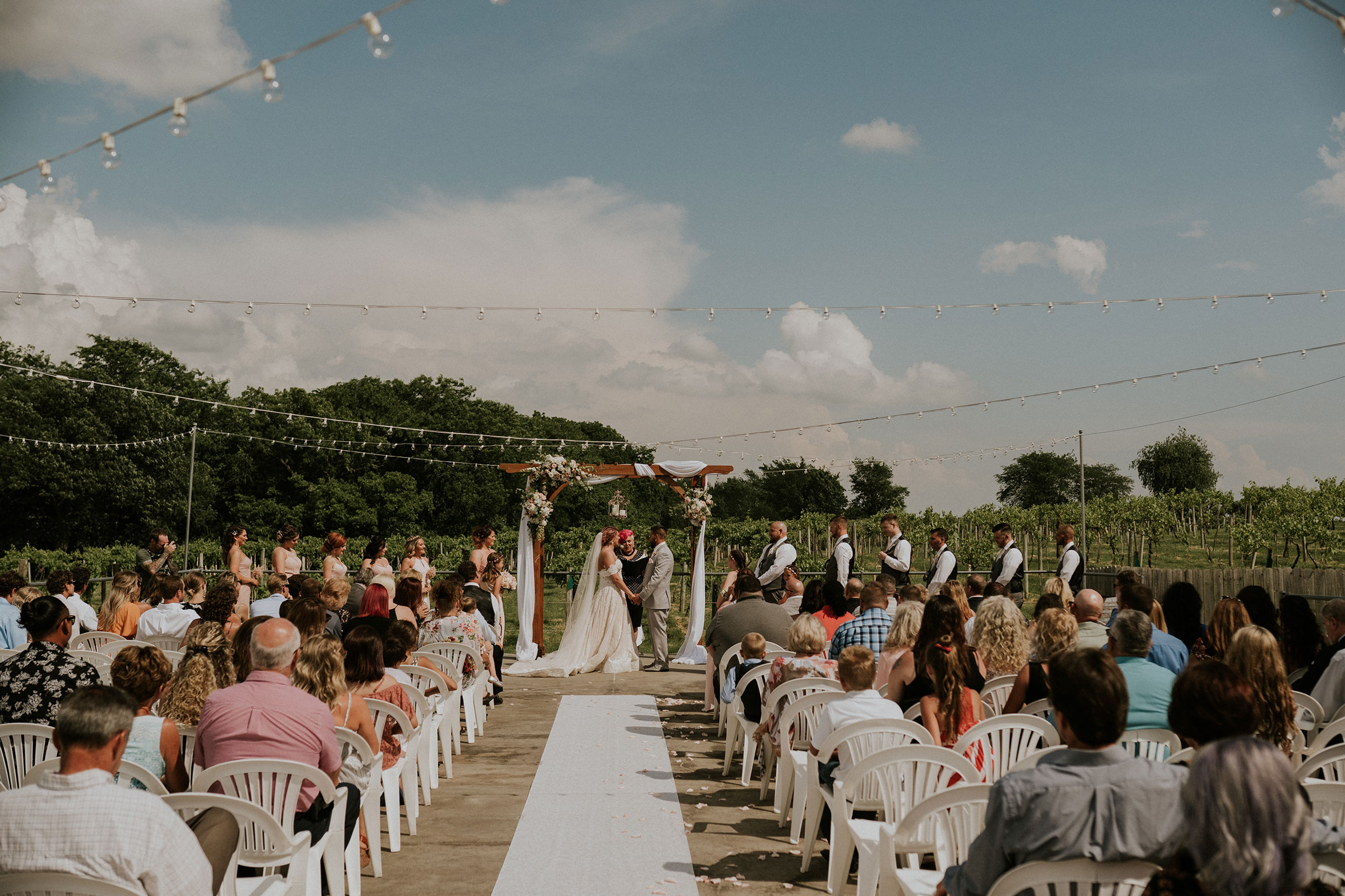 ceremony-location-wedding-summerset-winery-indianola-iowa-raelyn-ramey-photography.jpg