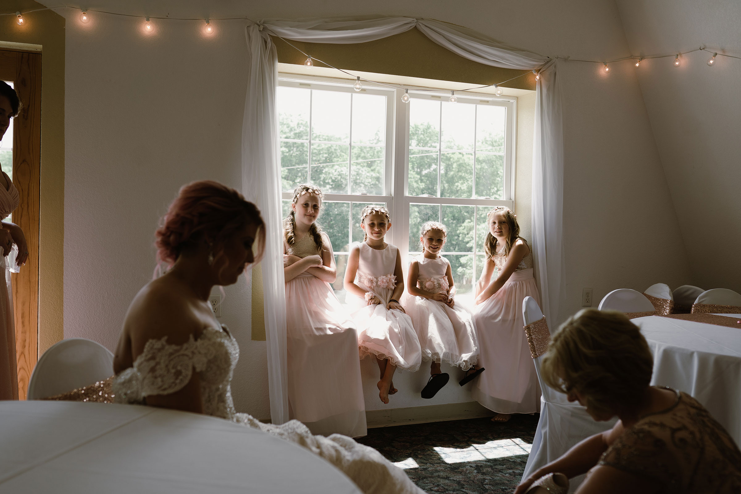 flower-girls-watching-bride-get-ready-wedding-summerset-winery-indianola-iowa-raelyn-ramey-photography.jpg