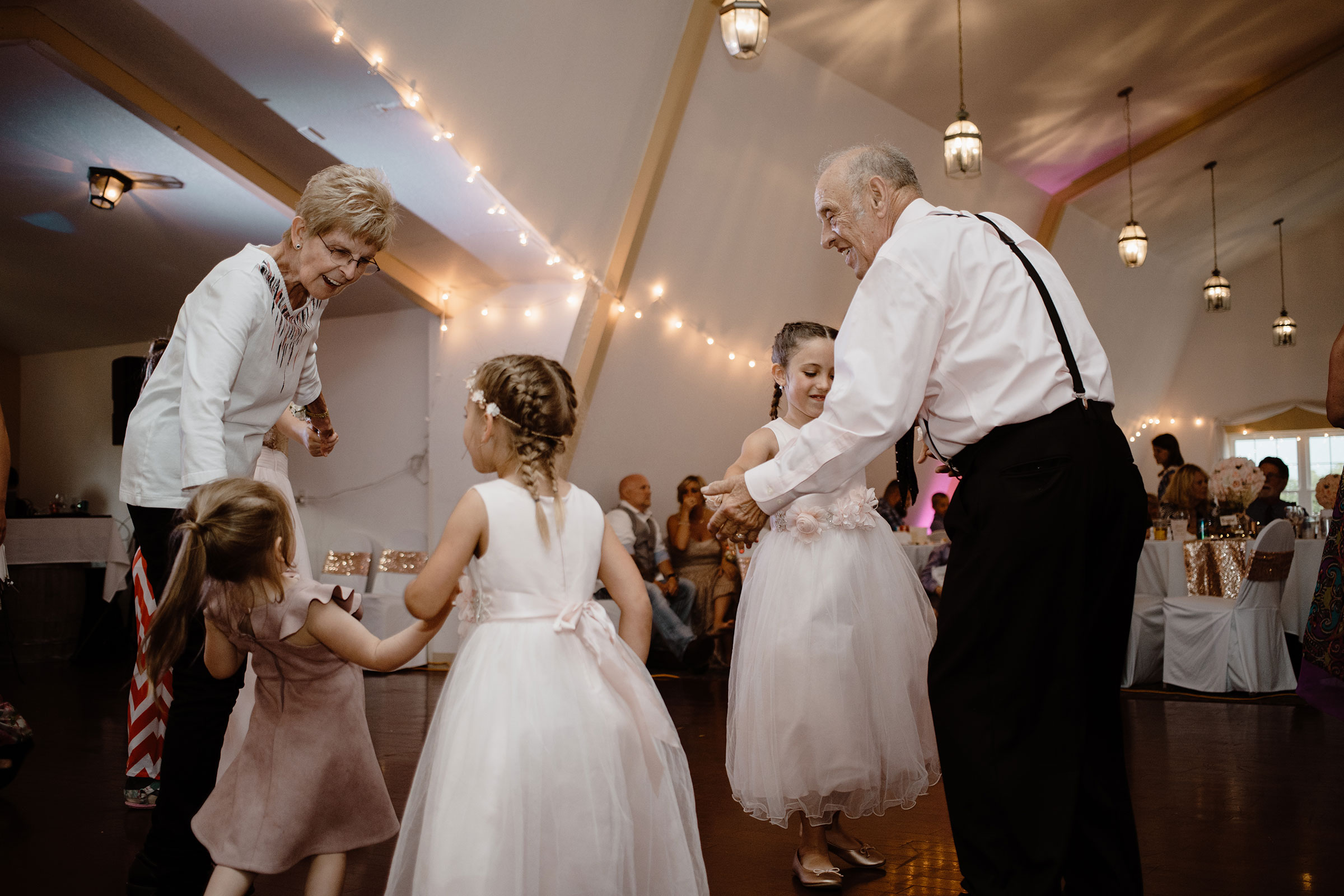 grandparents-dancing-with-granddaughters-wedding-summerset-winery-indianola-iowa-raelyn-ramey-photography.jpg