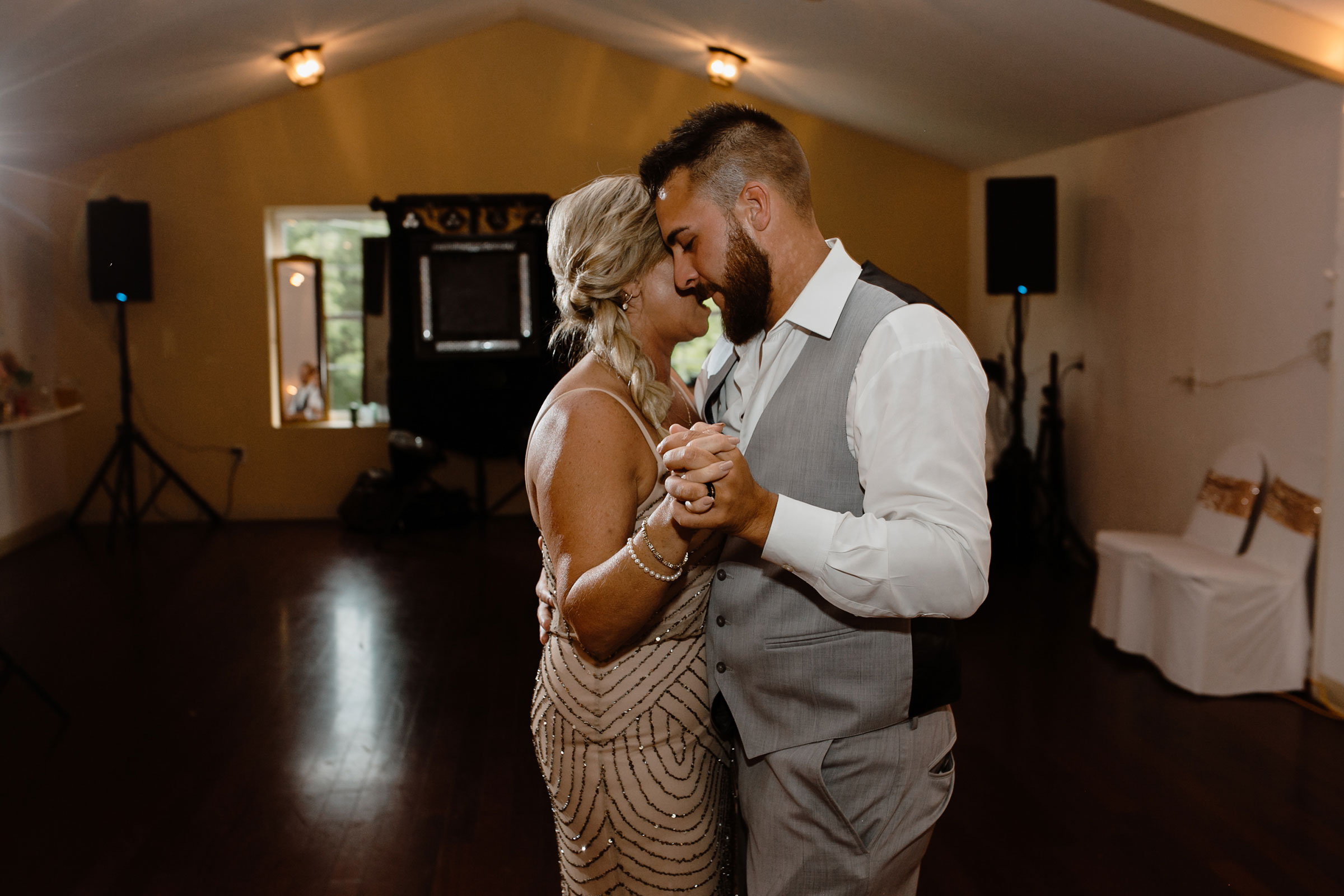 groom-and-mother-first-dance-wedding-summerset-winery-indianola-iowa-raelyn-ramey-photography.jpg