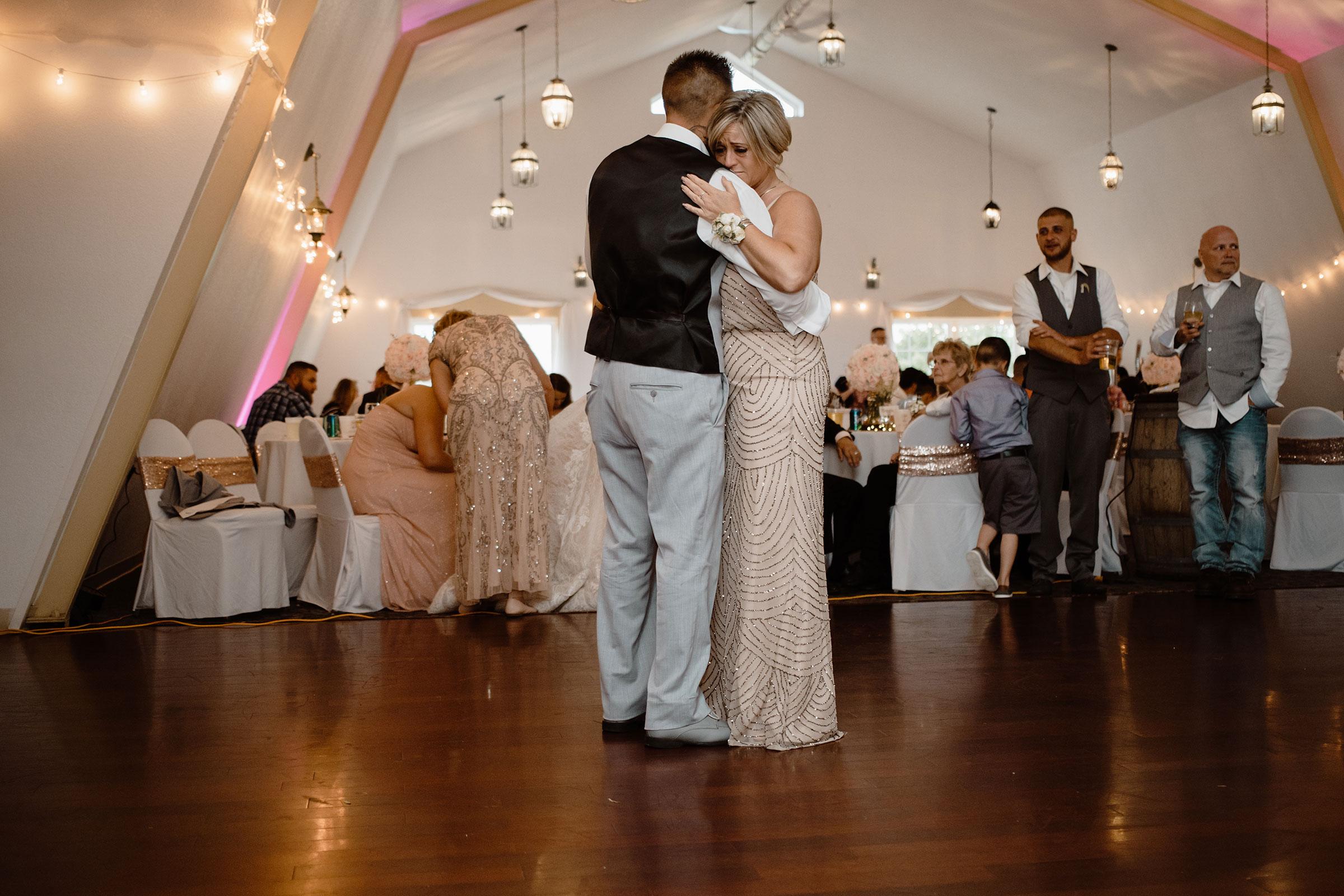 groom-dancing-with-crying-mother-wedding-summerset-winery-indianola-iowa-raelyn-ramey-photography.jpg