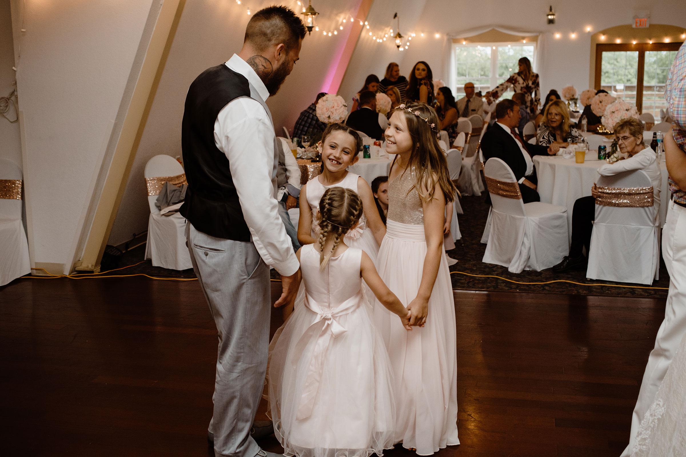 groom-dancing-with-his-three-daughters-wedding-summerset-winery-indianola-iowa-raelyn-ramey-photography.jpg