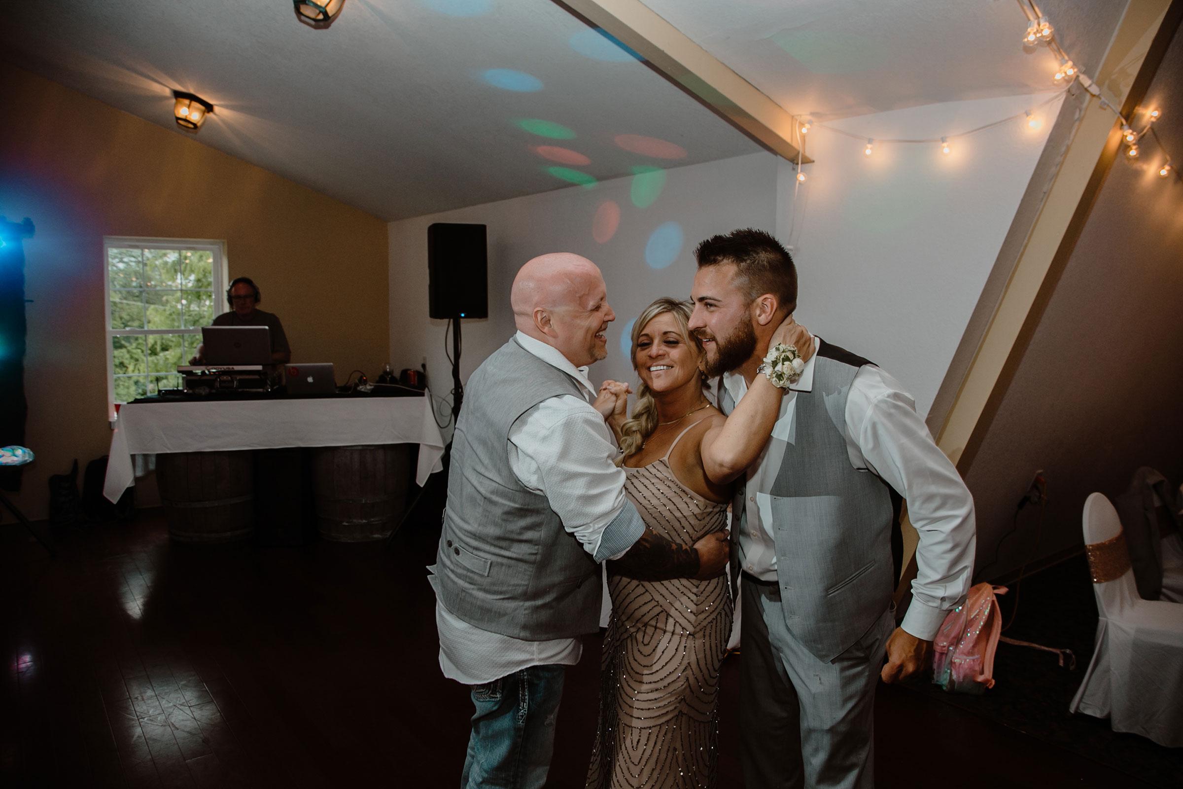 groom-dancing-with-mom-andstep-dad-wedding-summerset-winery-indianola-iowa-raelyn-ramey-photography.jpg