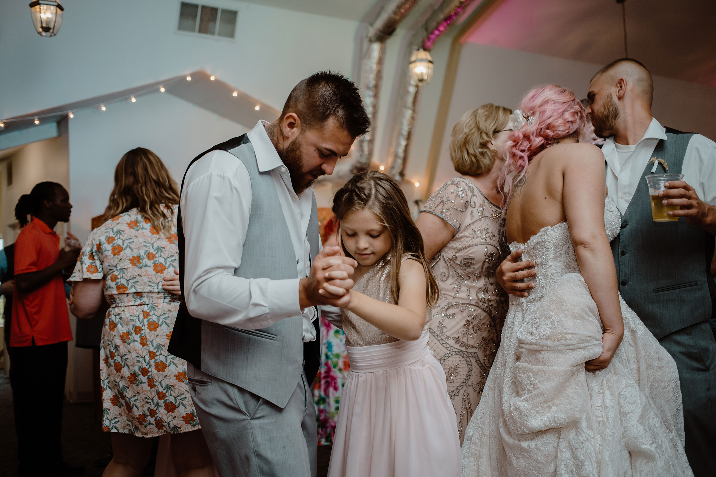 groom-dancing-with-oldest-daughter-wedding-summerset-winery-indianola-iowa-raelyn-ramey-photography.jpg