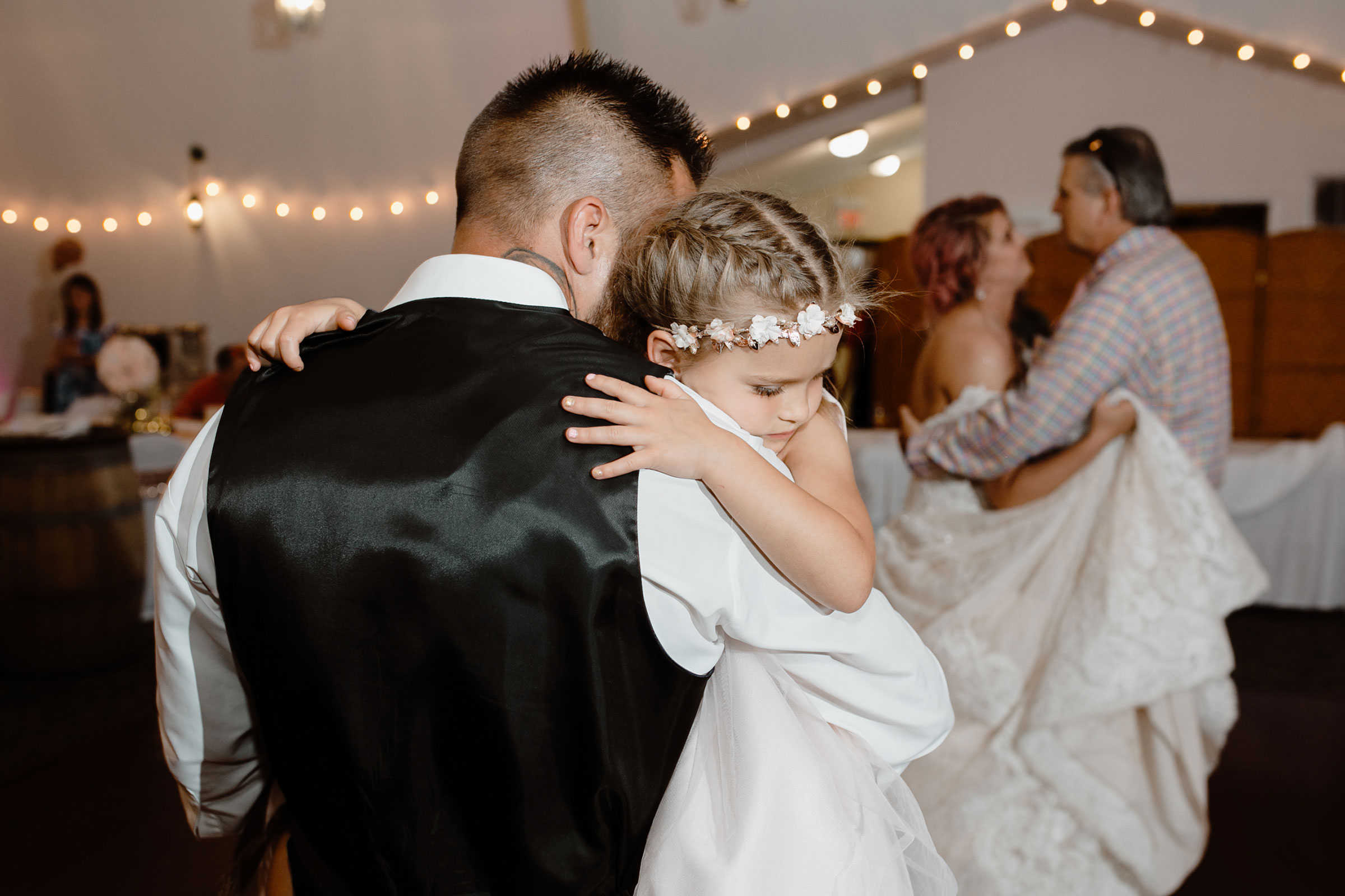 groom-holding-and-dancing-with-youngest-daughter-wedding-summerset-winery-indianola-iowa-raelyn-ramey-photography.jpg