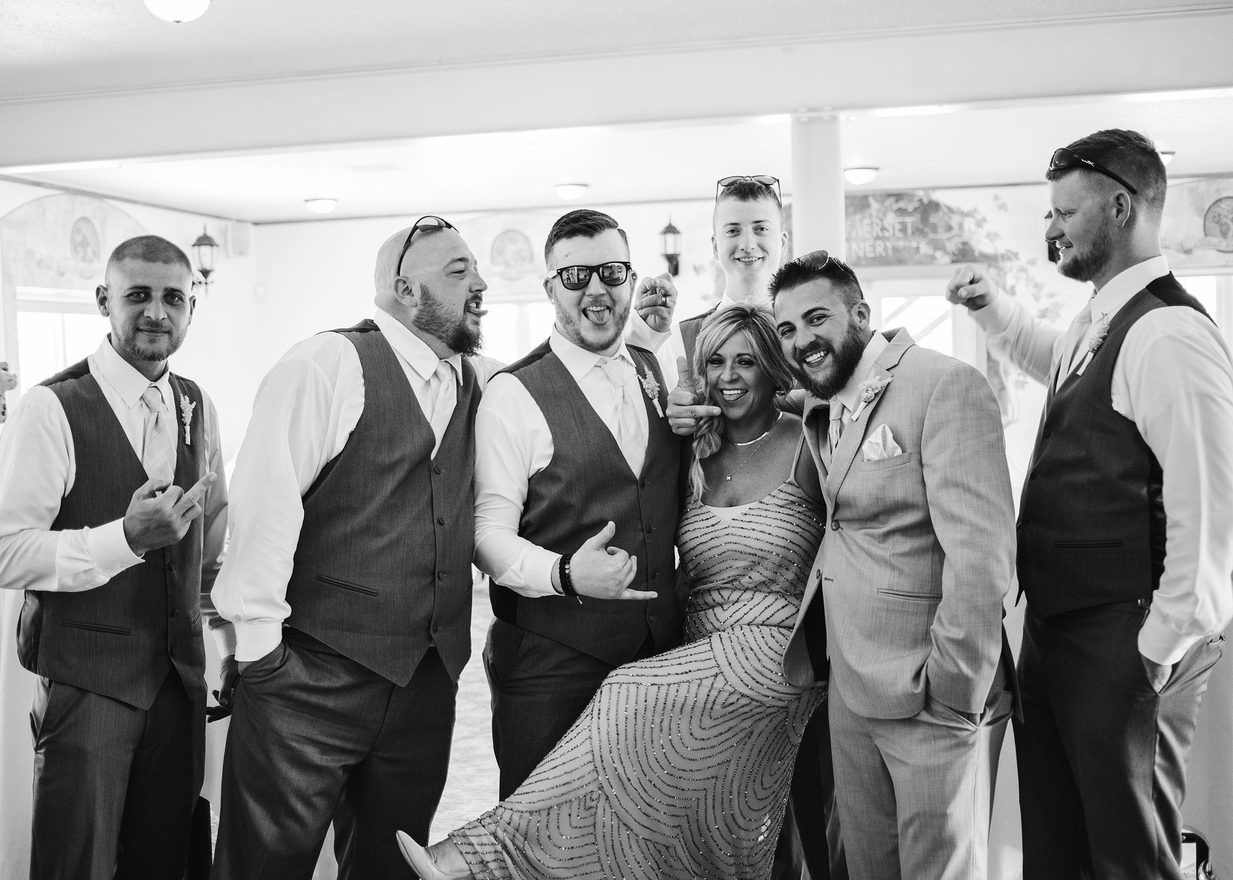 groomsmen-posing-with-mother-of-groom-wedding-summerset-winery-indianola-iowa-raelyn-ramey-photography.jpg