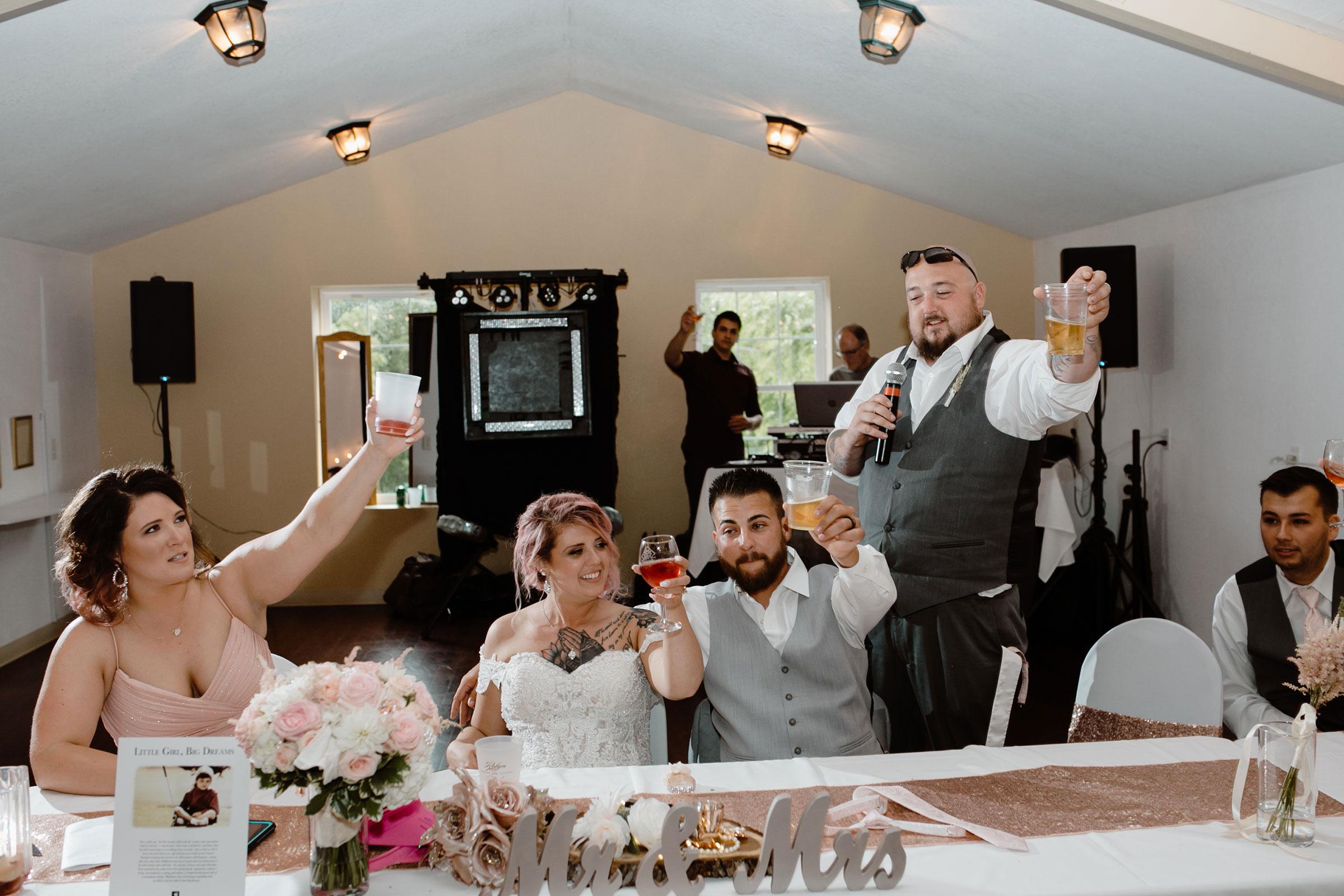 groomsmen-speech-cheers-wedding-summerset-winery-indianola-iowa-raelyn-ramey-photography.jpg