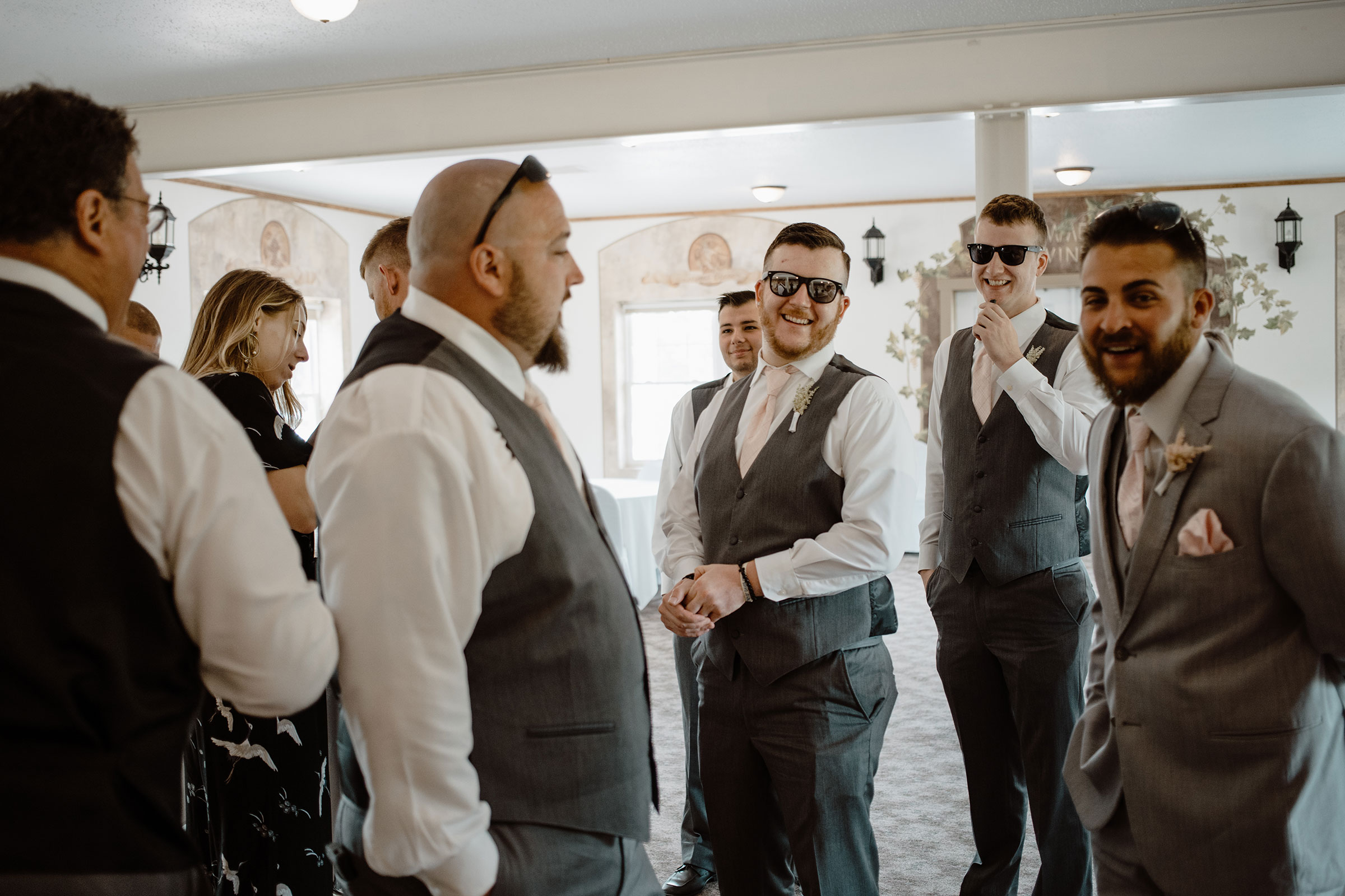 groomsmen-talking-and-laughing-wedding-summerset-winery-indianola-iowa-raelyn-ramey-photography.jpg