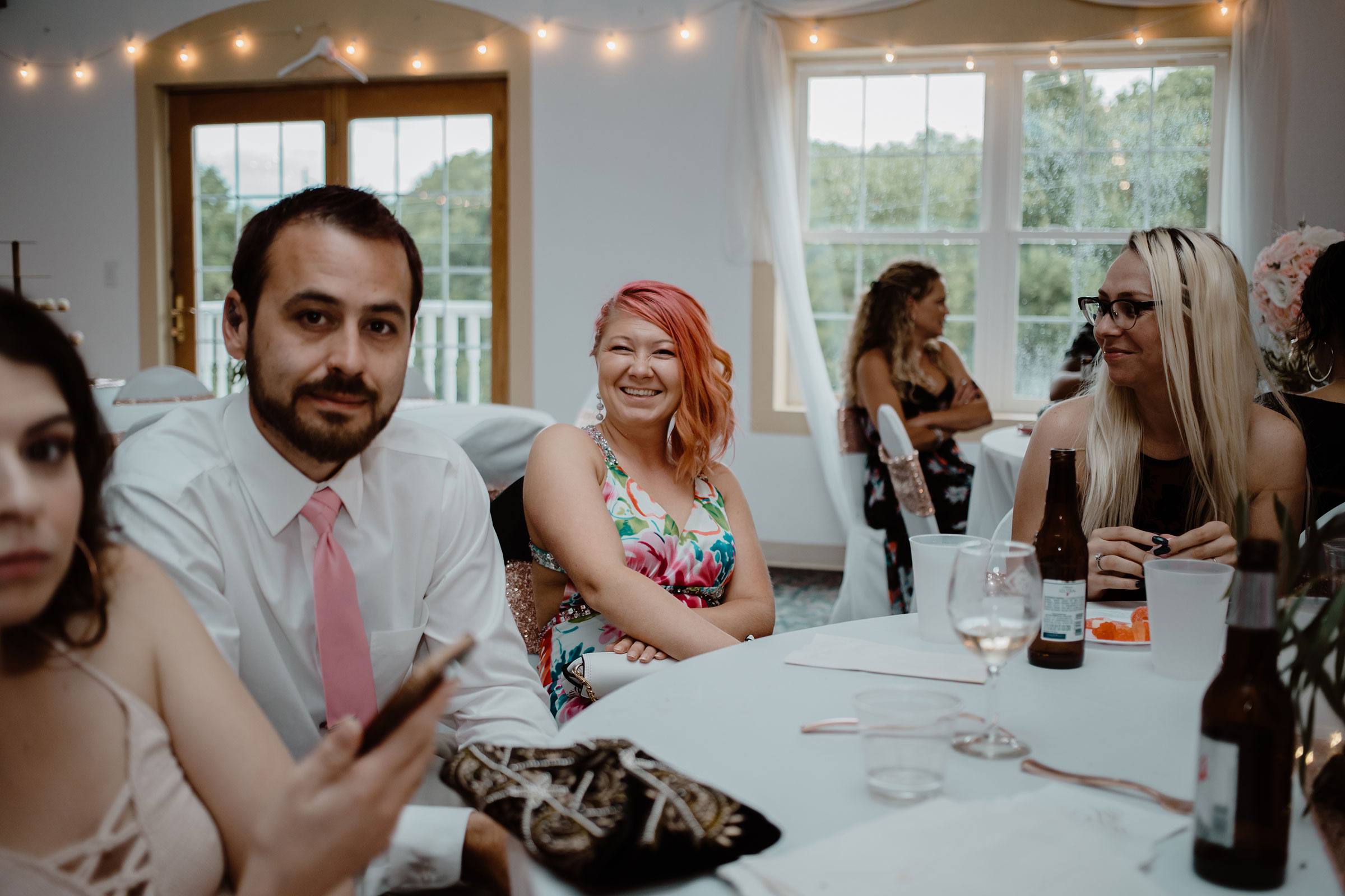guest-smiling-laughing-wedding-summerset-winery-indianola-iowa-raelyn-ramey-photography.jpg