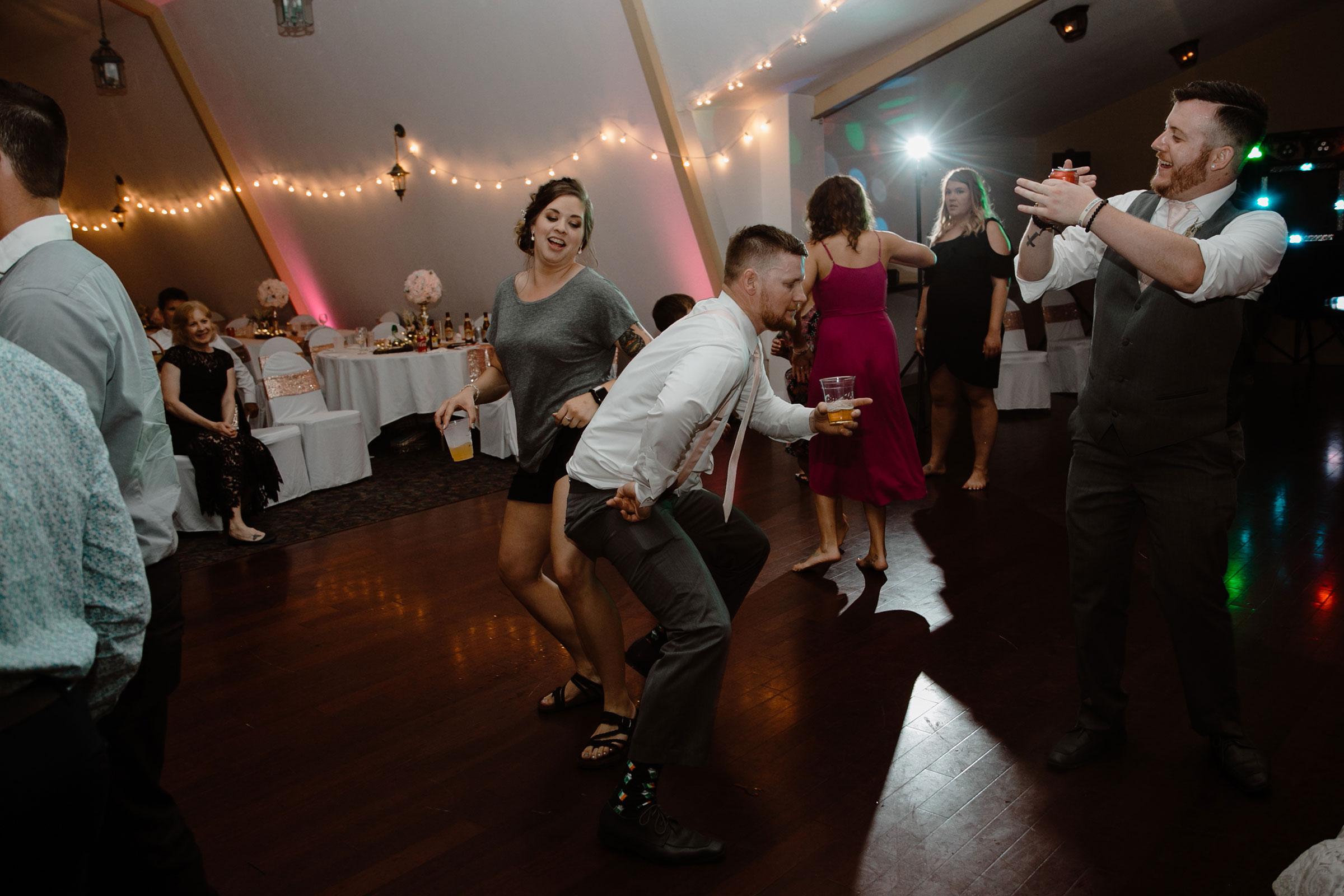 guest-twirking-on-dance-floor-wedding-summerset-winery-indianola-iowa-raelyn-ramey-photography.jpg