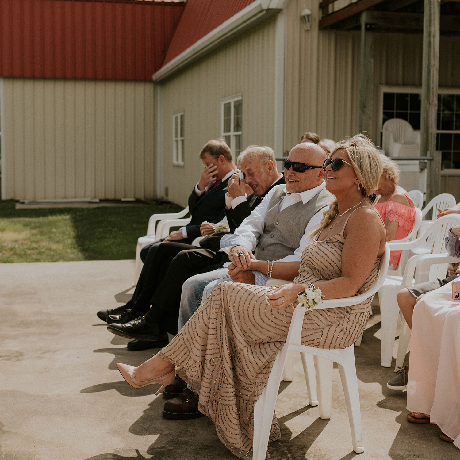 parents-of-groom-crying-during-ceremony-wedding-summerset-winery-indianola-iowa-raelyn-ramey-photography.jpg