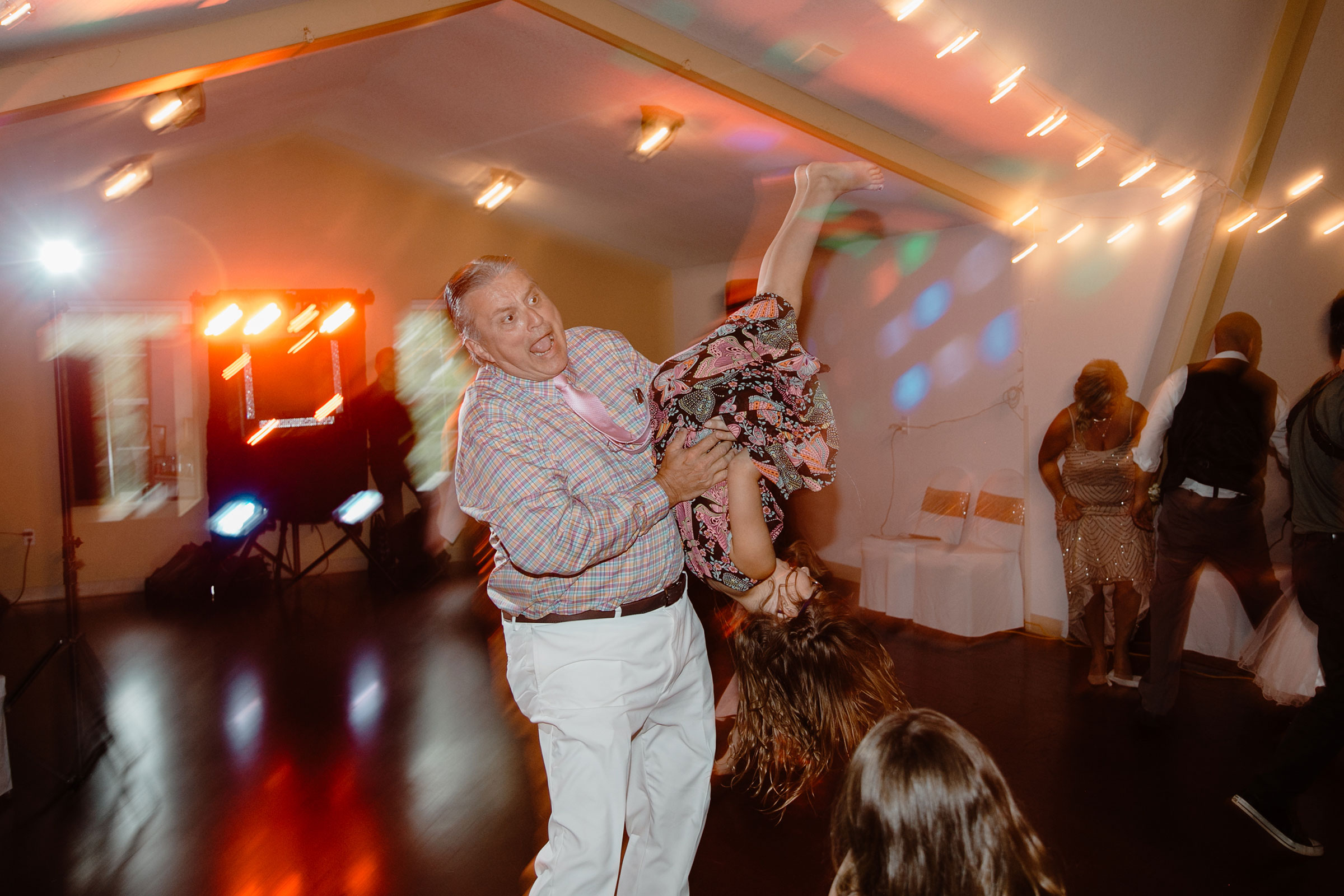 step-father-flipping-kid-upside-down-wedding-summerset-winery-indianola-iowa-raelyn-ramey-photography.jpg