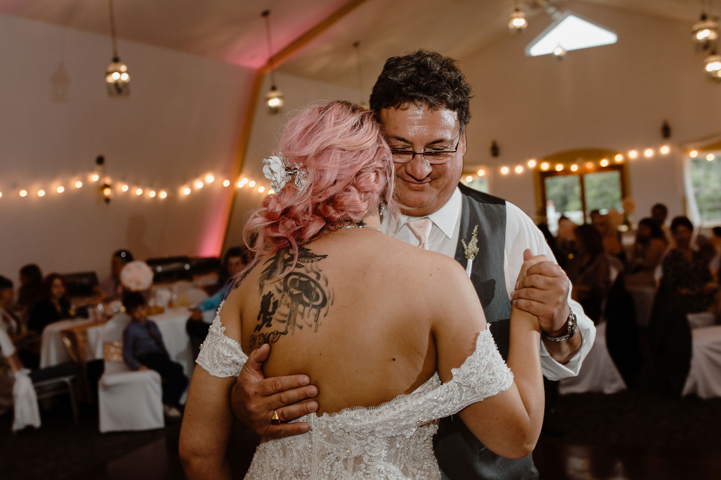 up-close-shot-of-father-dancing-with-bride-wedding-summerset-winery-indianola-iowa-raelyn-ramey-photography.jpg