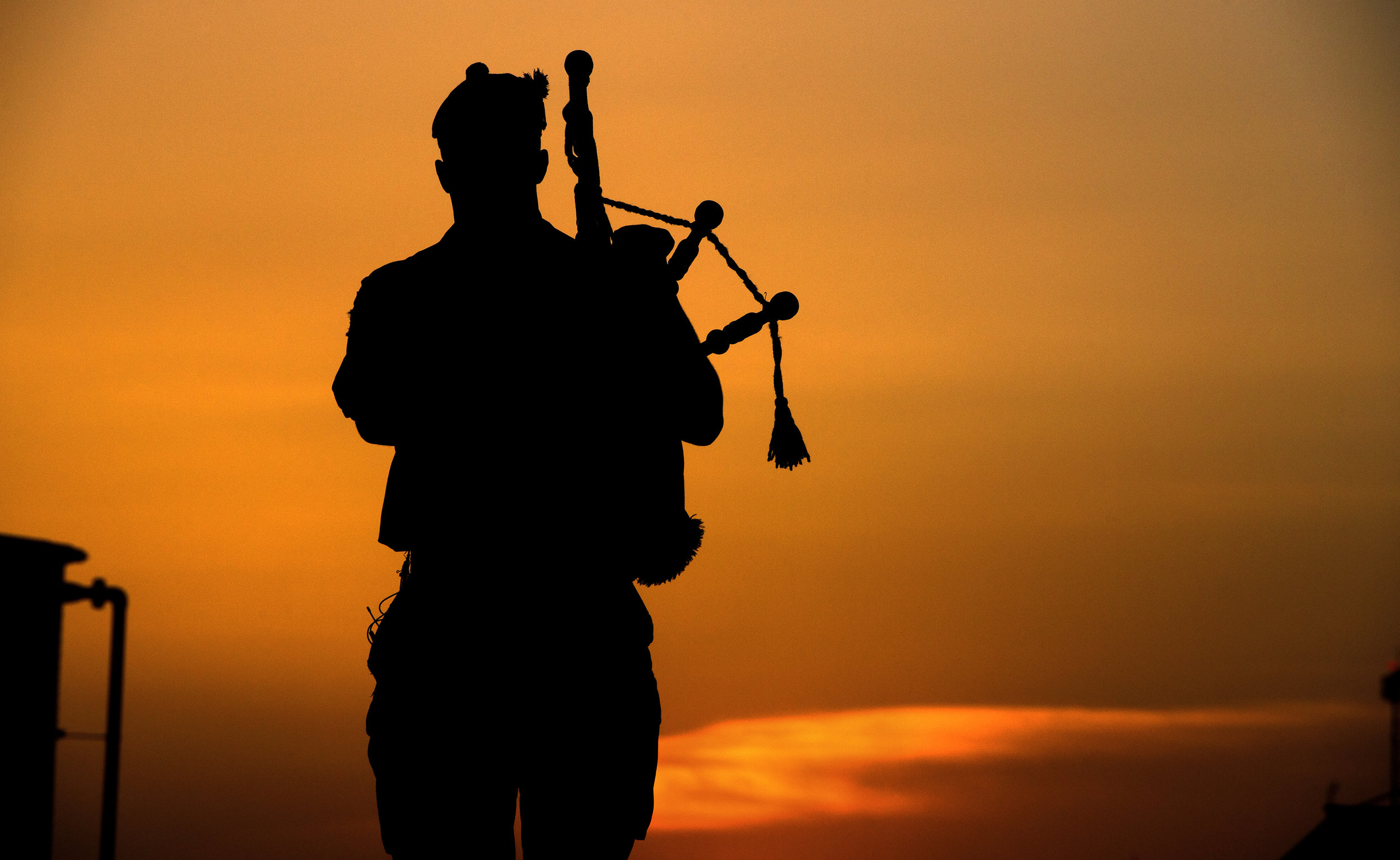 Piper_with_4_SCOTS_Playing_as_the_Sun_Goes_Down_in_Afghanistan_MOD_45157896.jpg