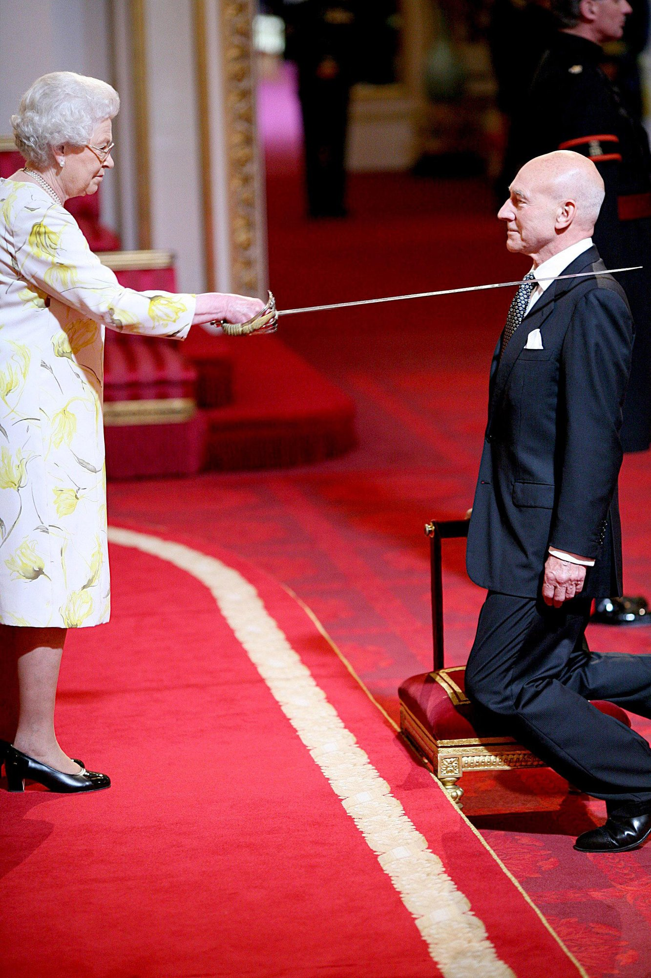 Queen Elizabeth II knighting Sir Patrick Stewart