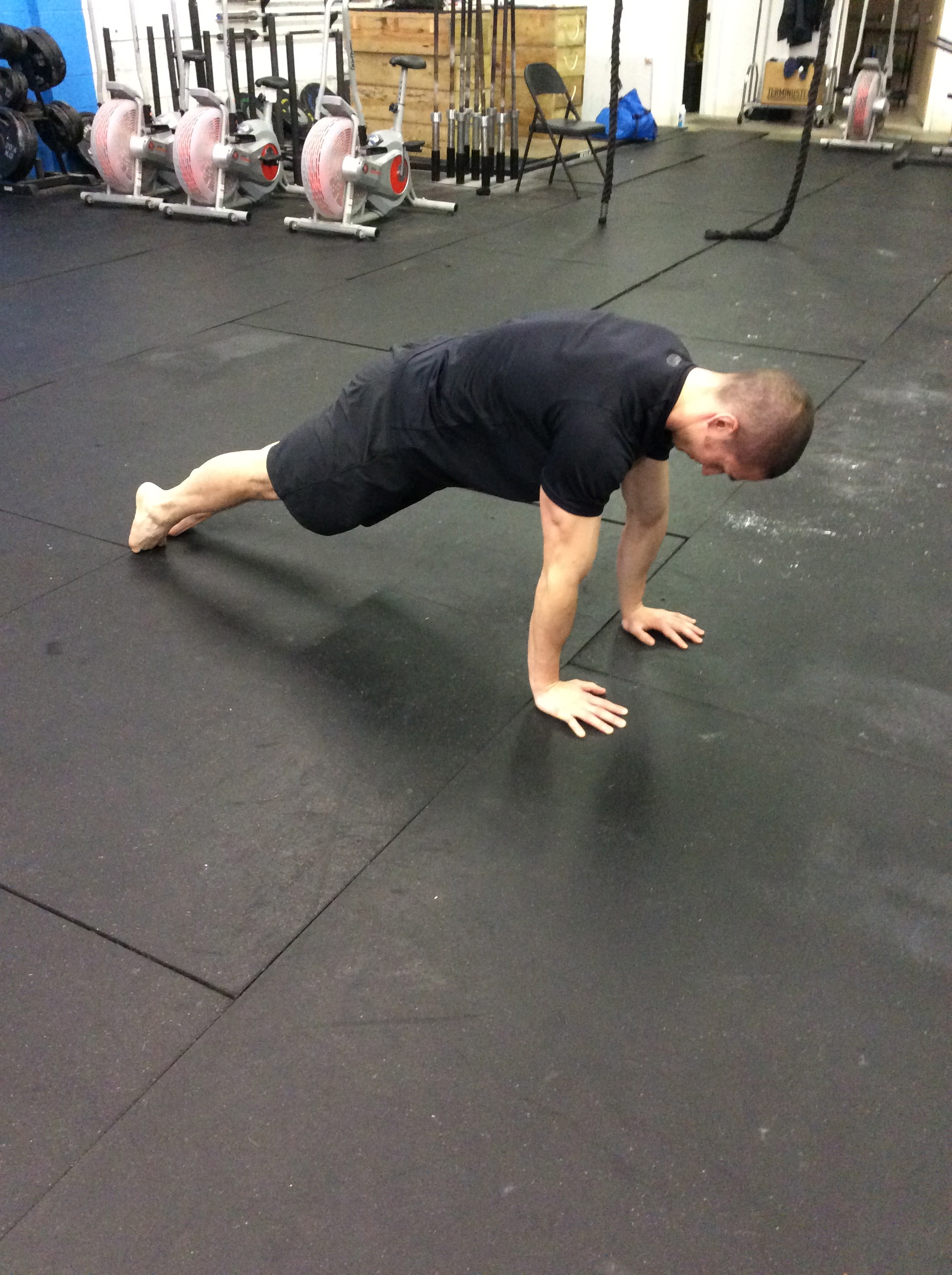 Am I holding a plank or stopping at the top of a push-up?
