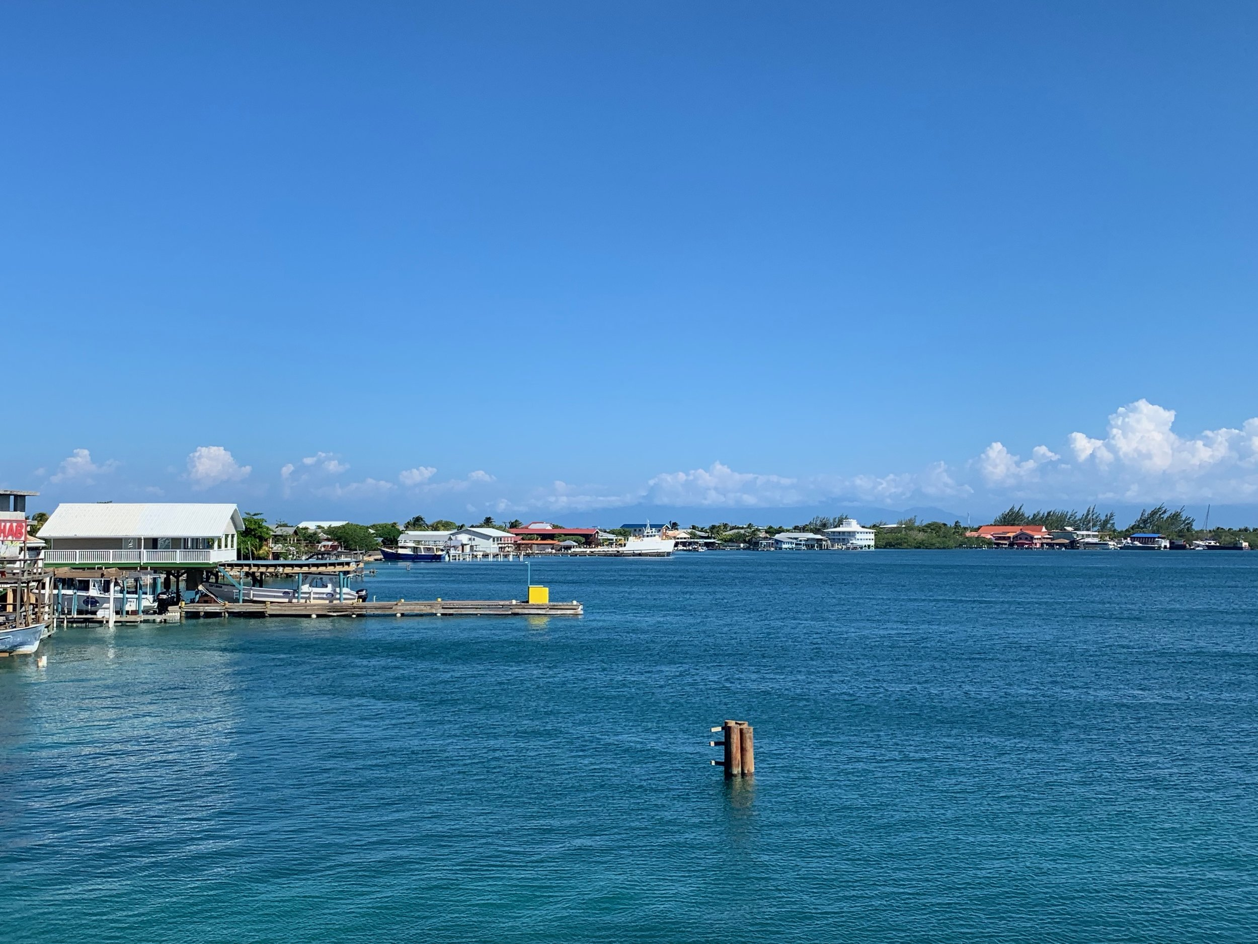 View from the dock of Utila, Honduras; the ship decks of the dive centers lining the water