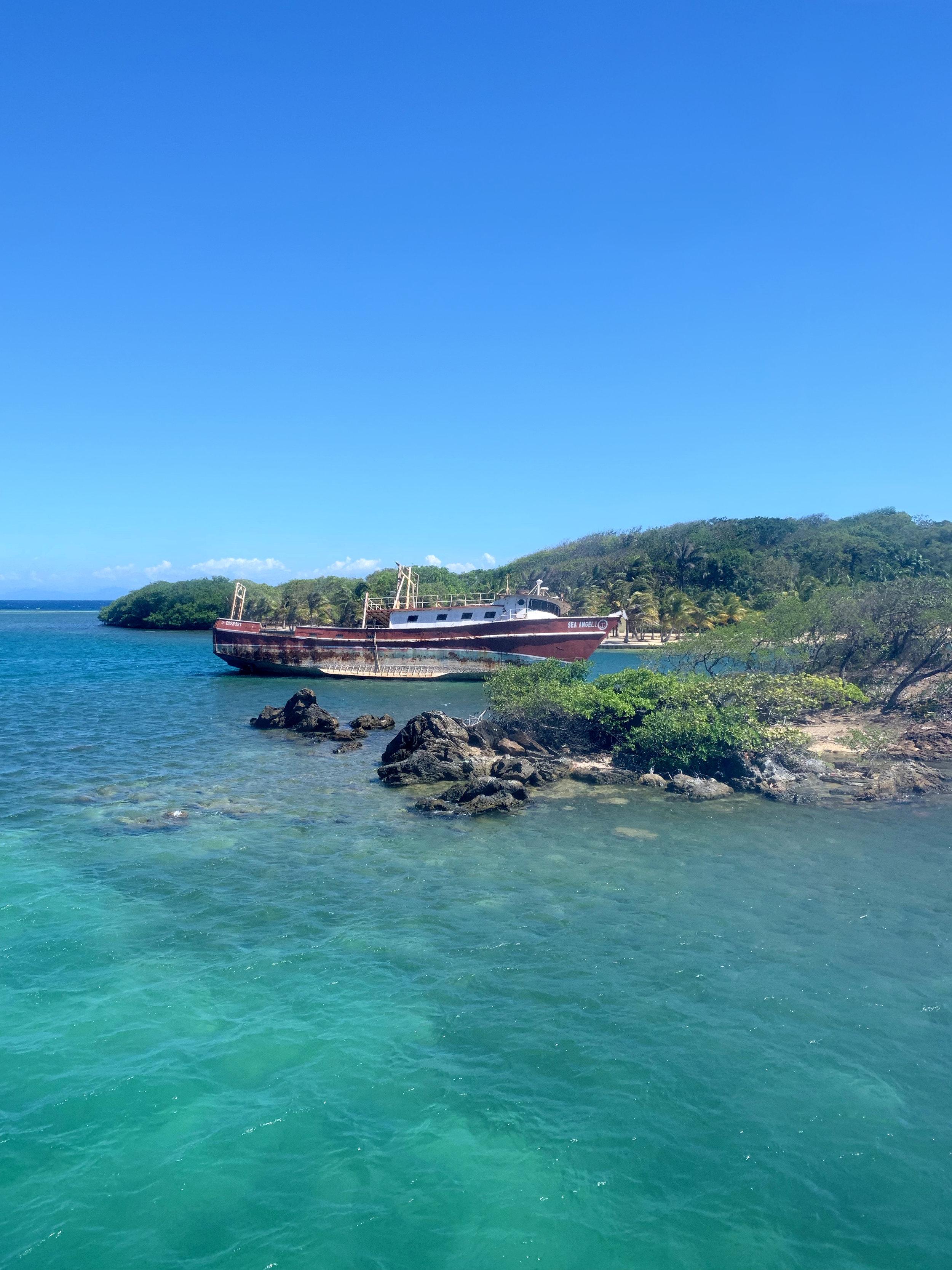 Decaying ship vessel off of the beach of Roatan, Honduras