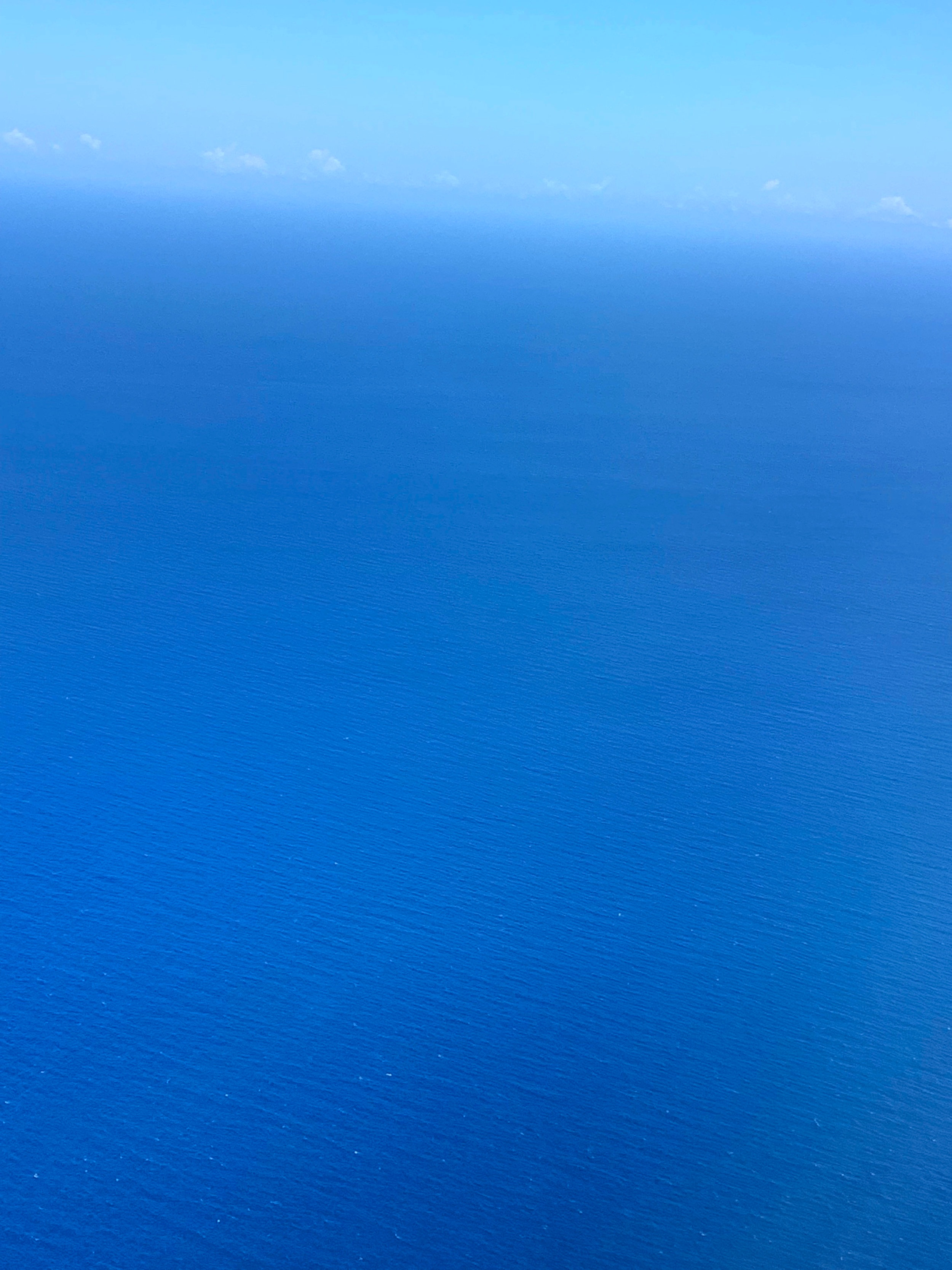 View from the window of my airplane, looking over the sea