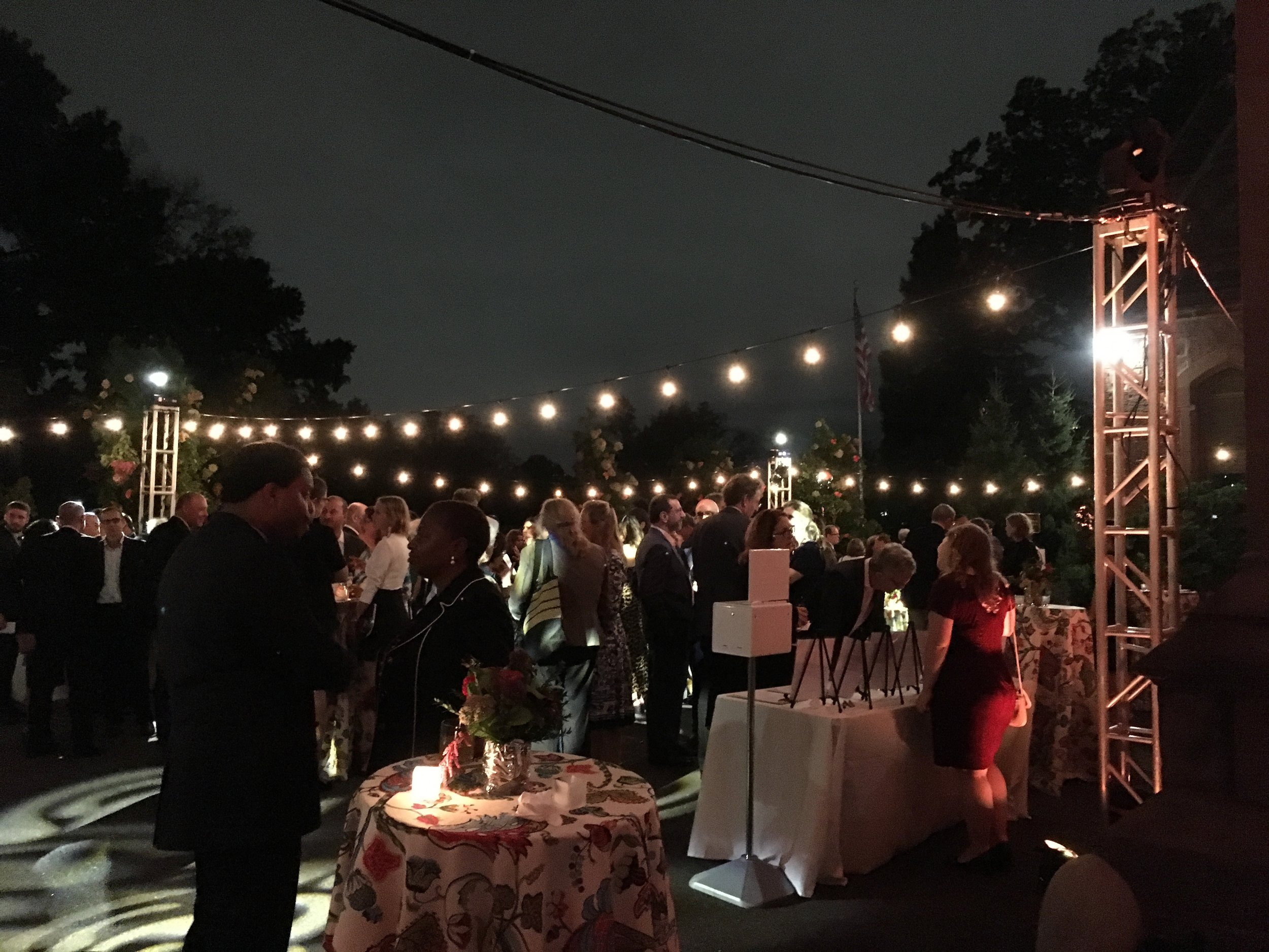 Bistro lighting and moving gobos for an outdoor cocktail event
