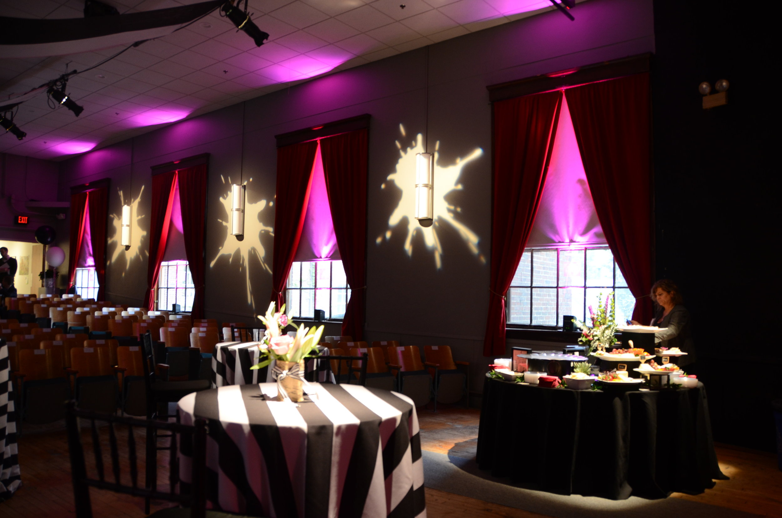 Pinspots and custom gobos to match the theme of a fundraiser
