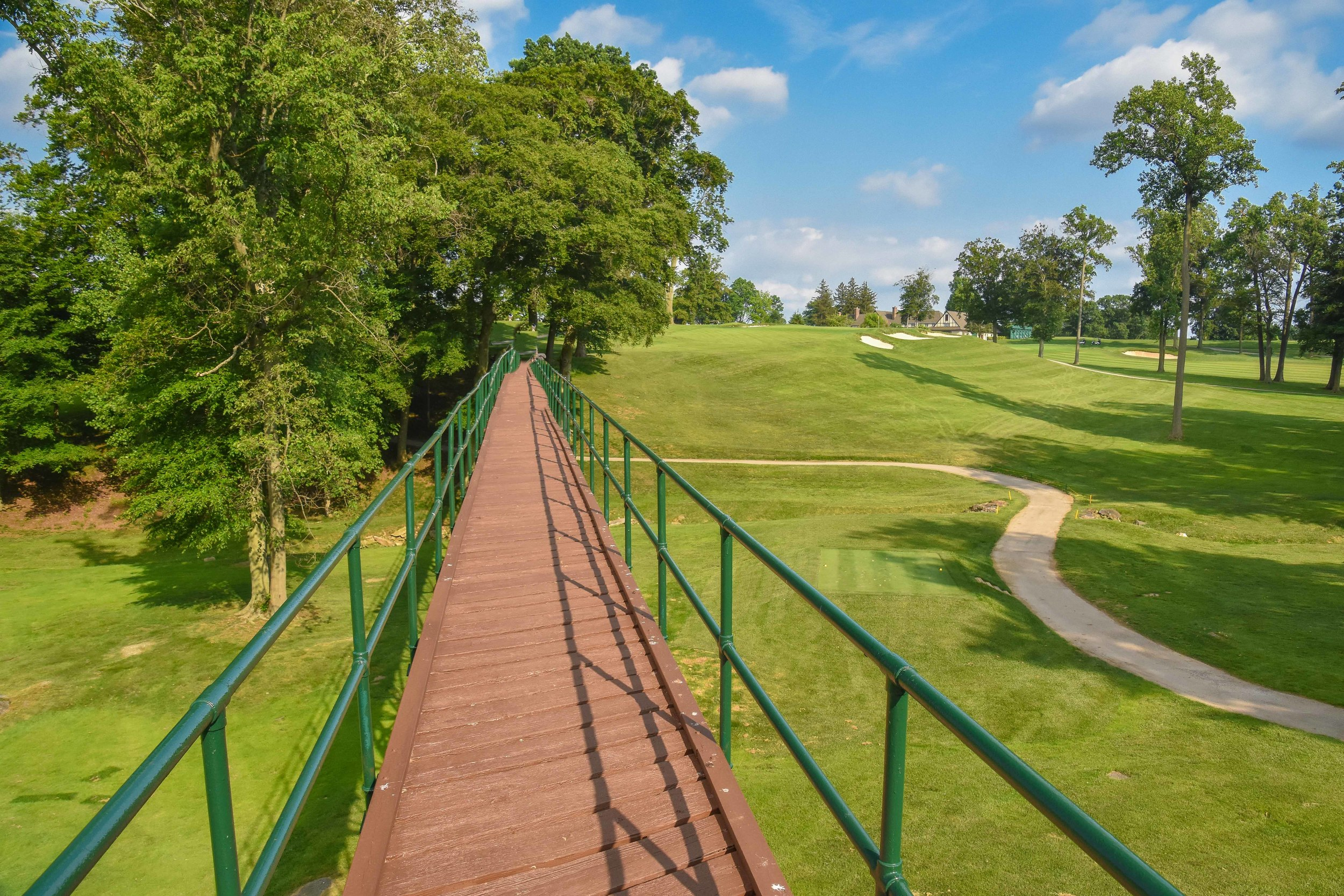 The unique walking bridge on the long par 3 14th hole at Rolling Green.