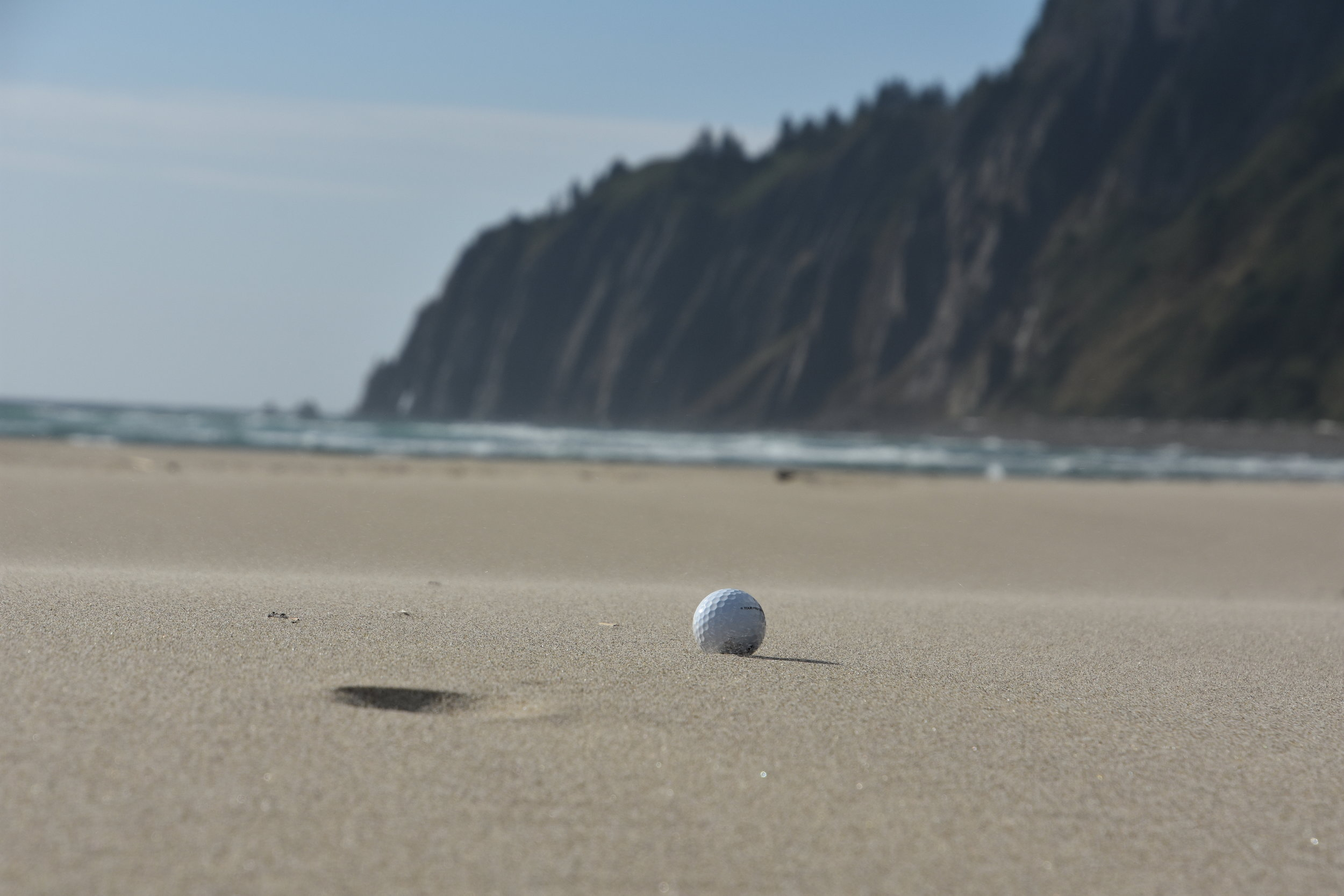 The ball just lies there, waiting, beckoning to be struck.  It rests gently in the sand, tempting you.  Come and play!!