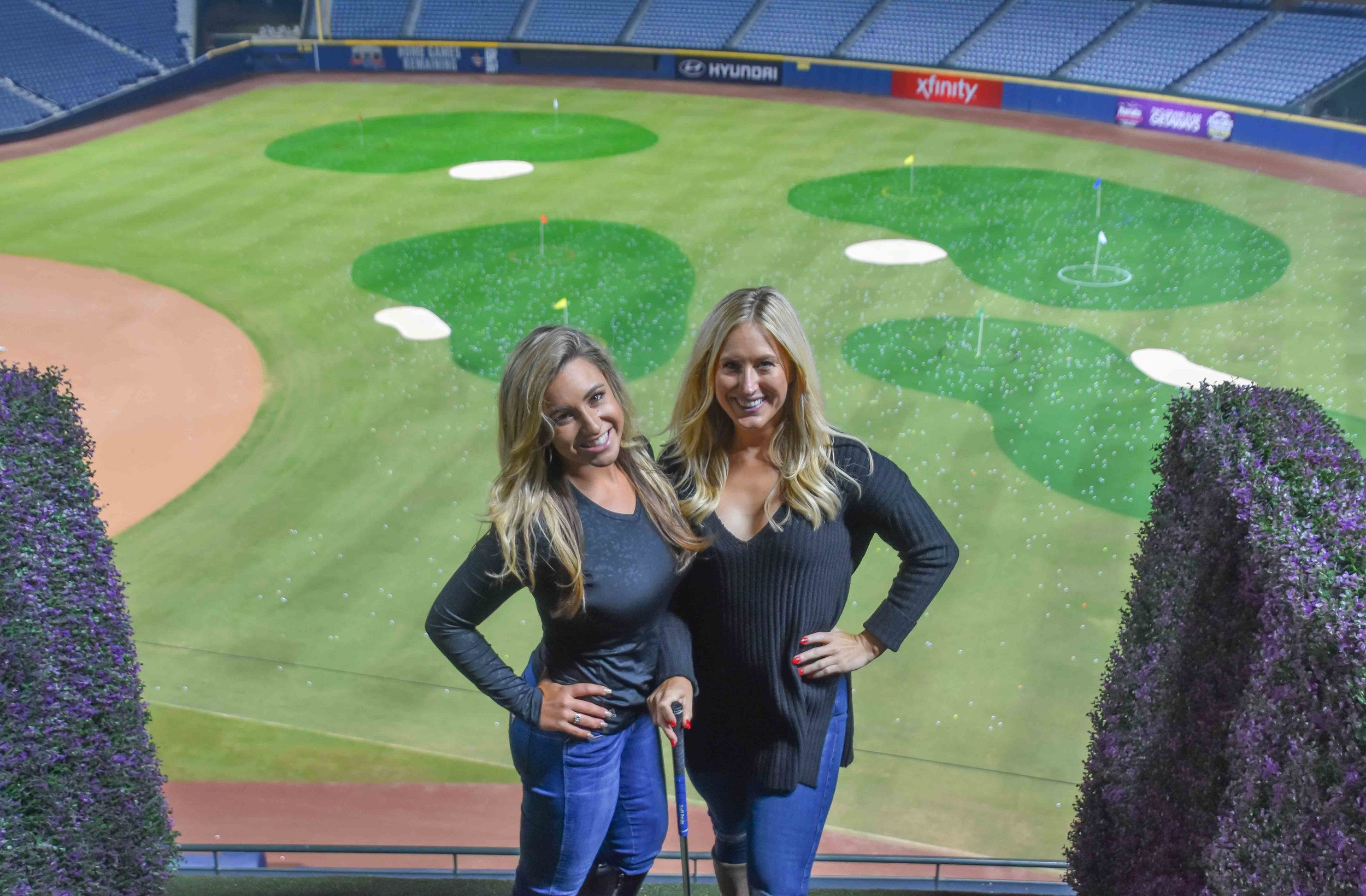 Chelsea Pezzola  and  Fiamma Felitch  do some Turner Field golf modeling.