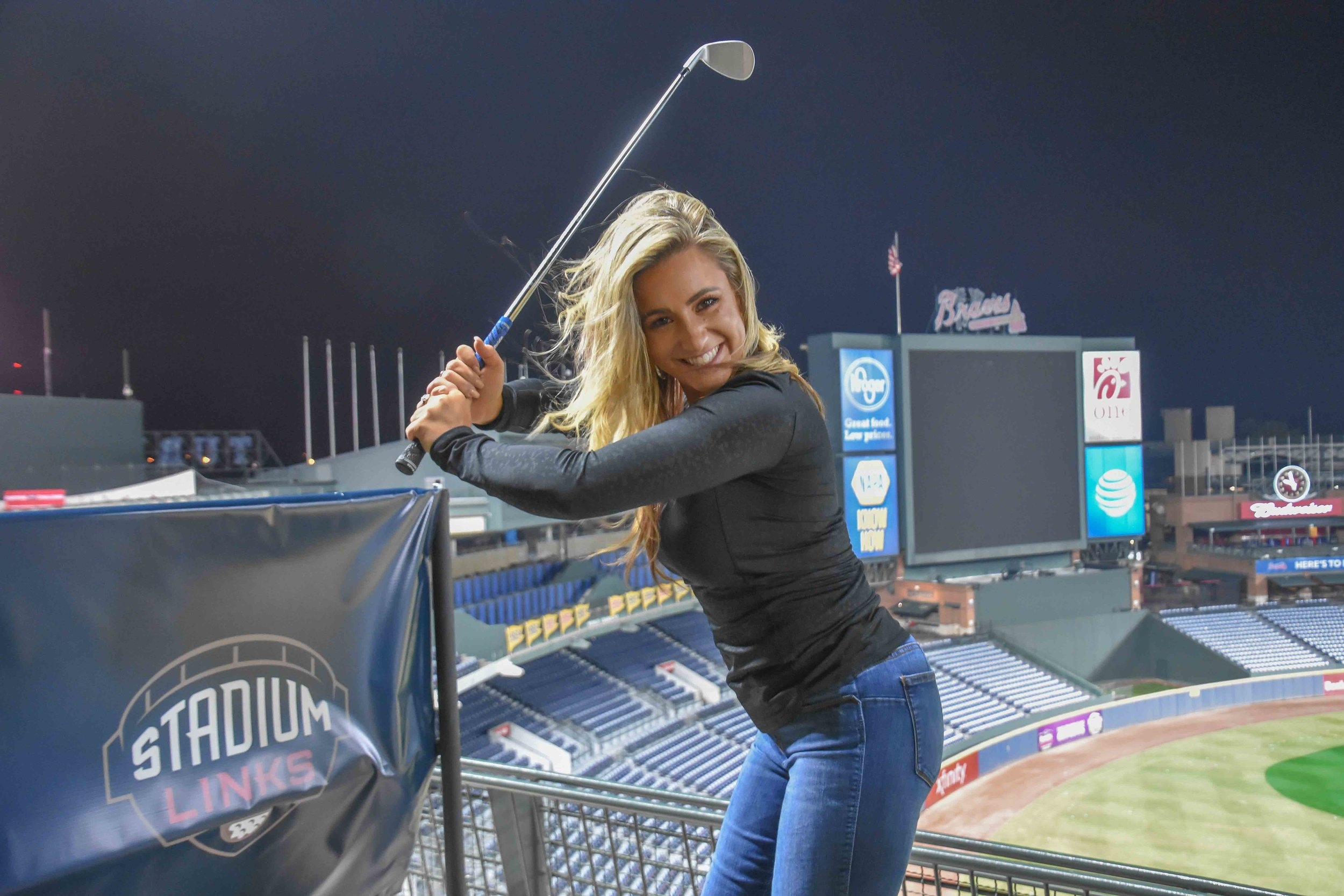 Chelsea Pezzola  mixes up baseball and golf, in the classic basegolf pose.