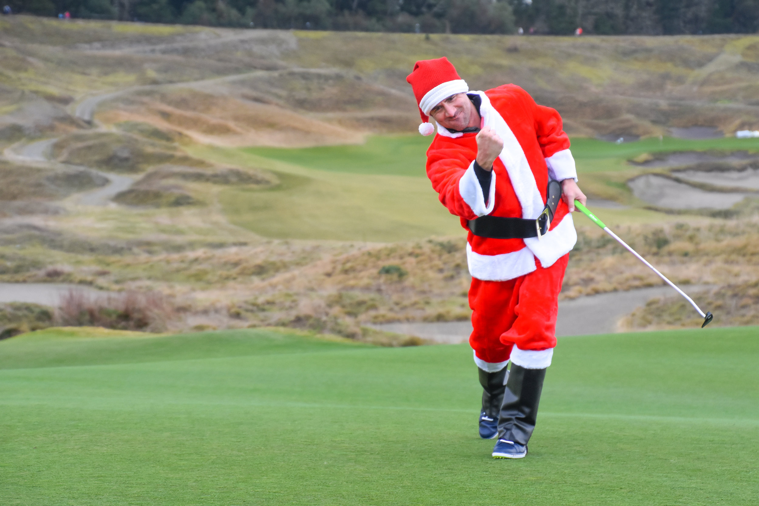 The Santa fist pump is second only to the Tiger fist pump.