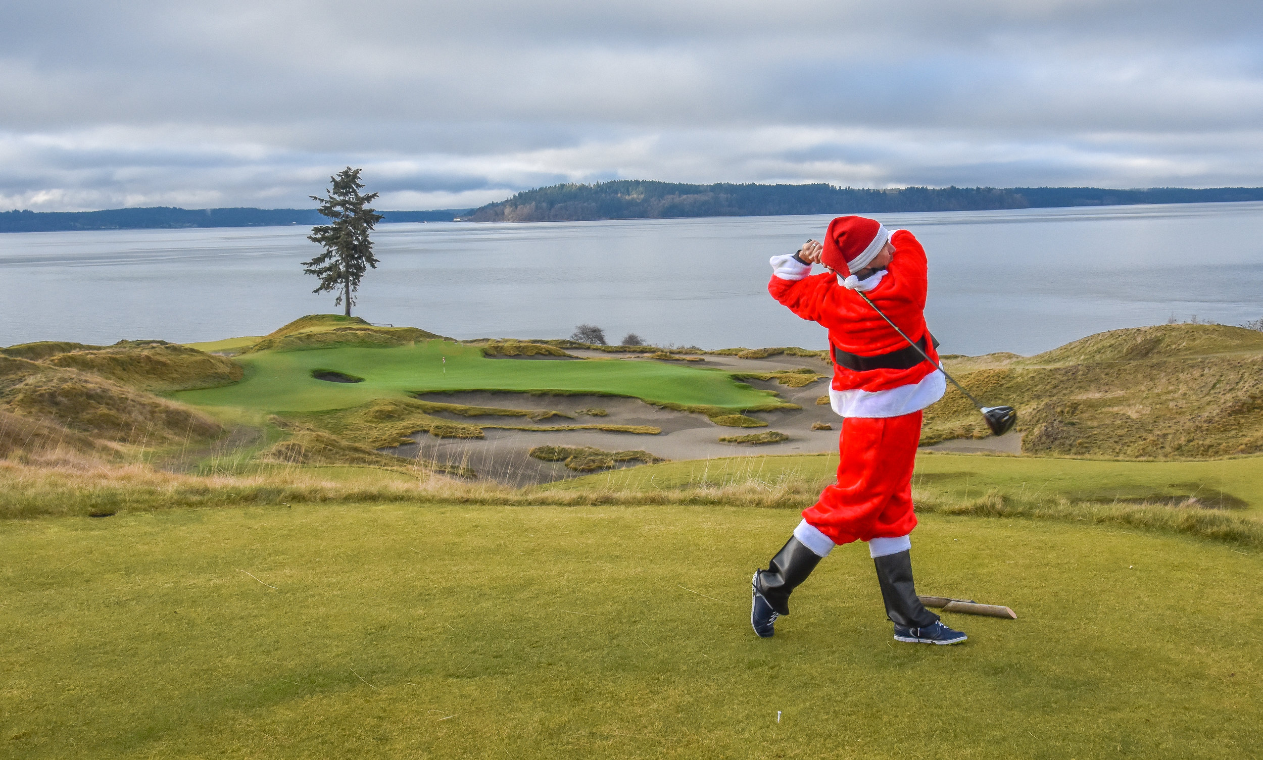 Santa goes for the green on the short par 4 12th as the 15th green lights up the background.