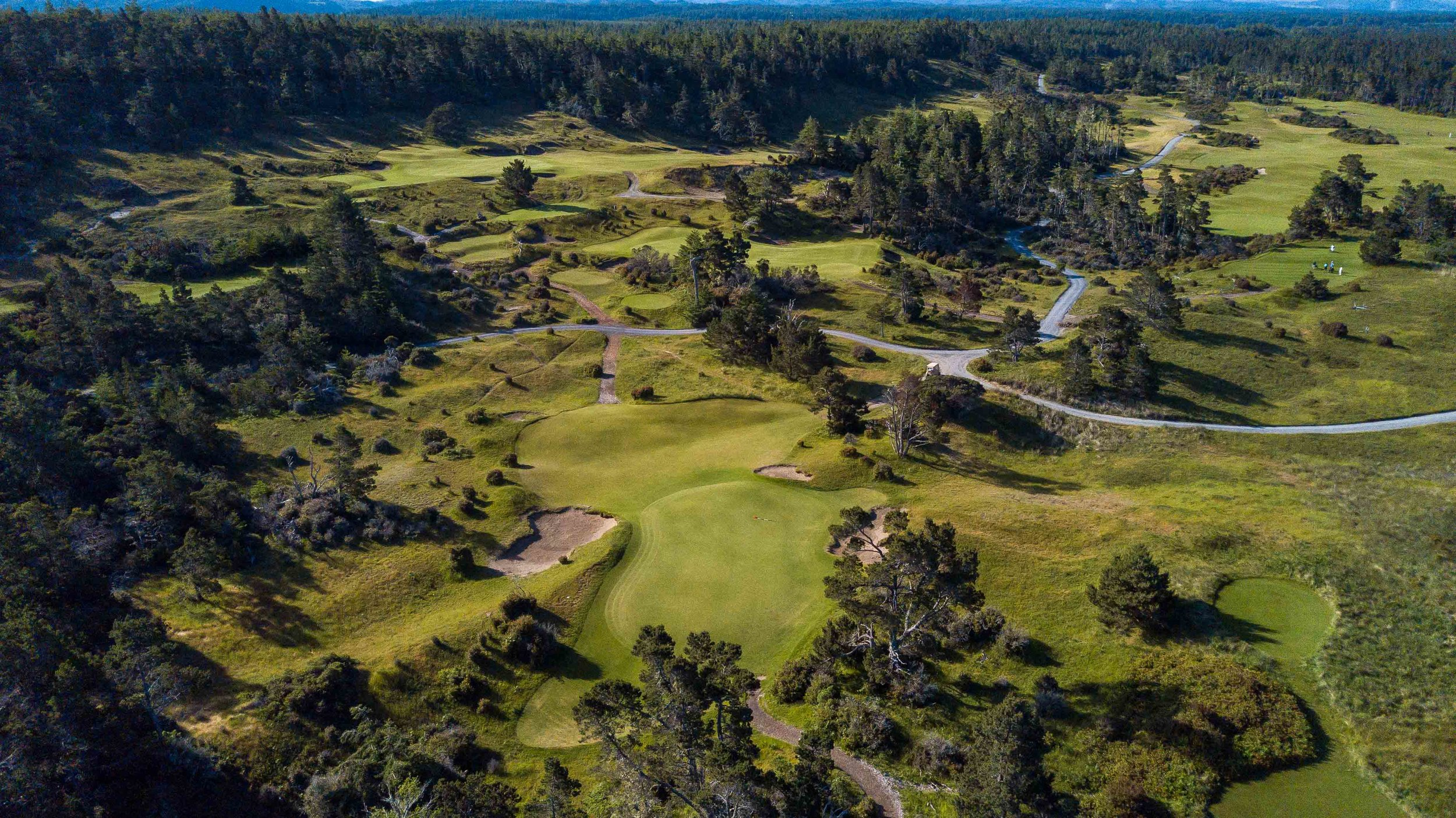 In one of our team's first round highlights, we made a 4 footer for par on the relatively easy 17th hole at Bandon Trails.  The highlight reel was sparse, the aerial footage was plentiful.