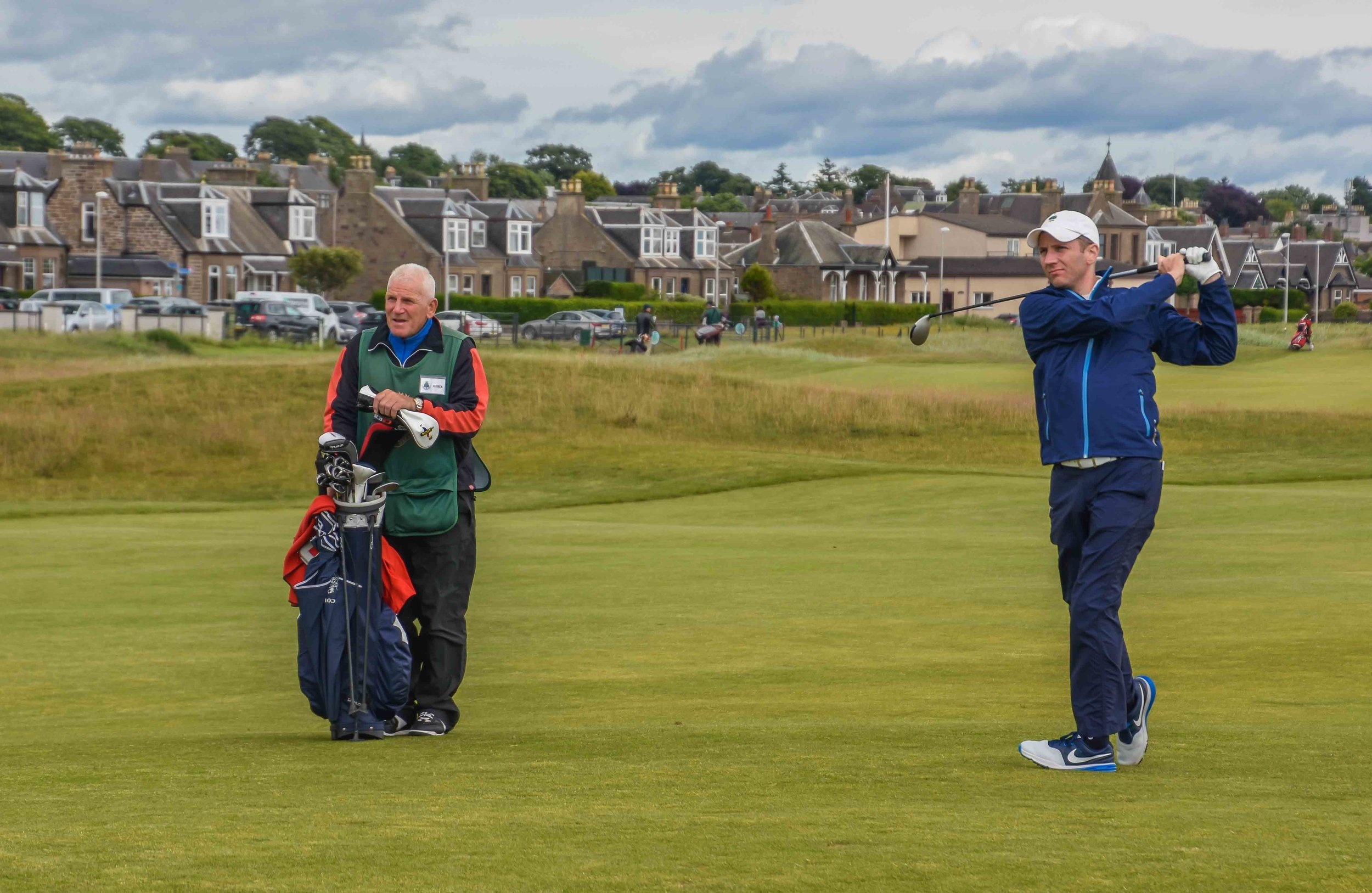 "Tom would smoke his the 3 wood into the wind on the difficult 17th ""Island"" hole at Carnoustie.  You can sense the amazement in the face of the caddie as Tom finds the green."
