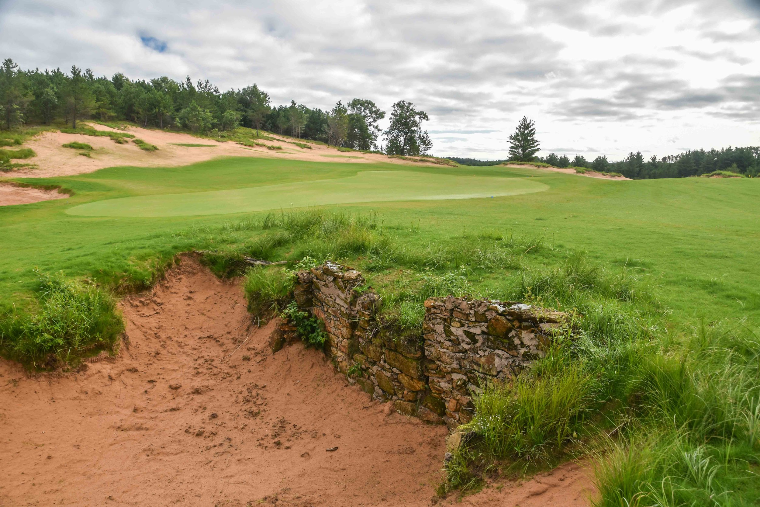 While creating Mammoth Dunes, Kidd and his team uncovered an old housing foundation.  Instead of removing it, they made a bunker out of it.  It's gnarly and awesome.