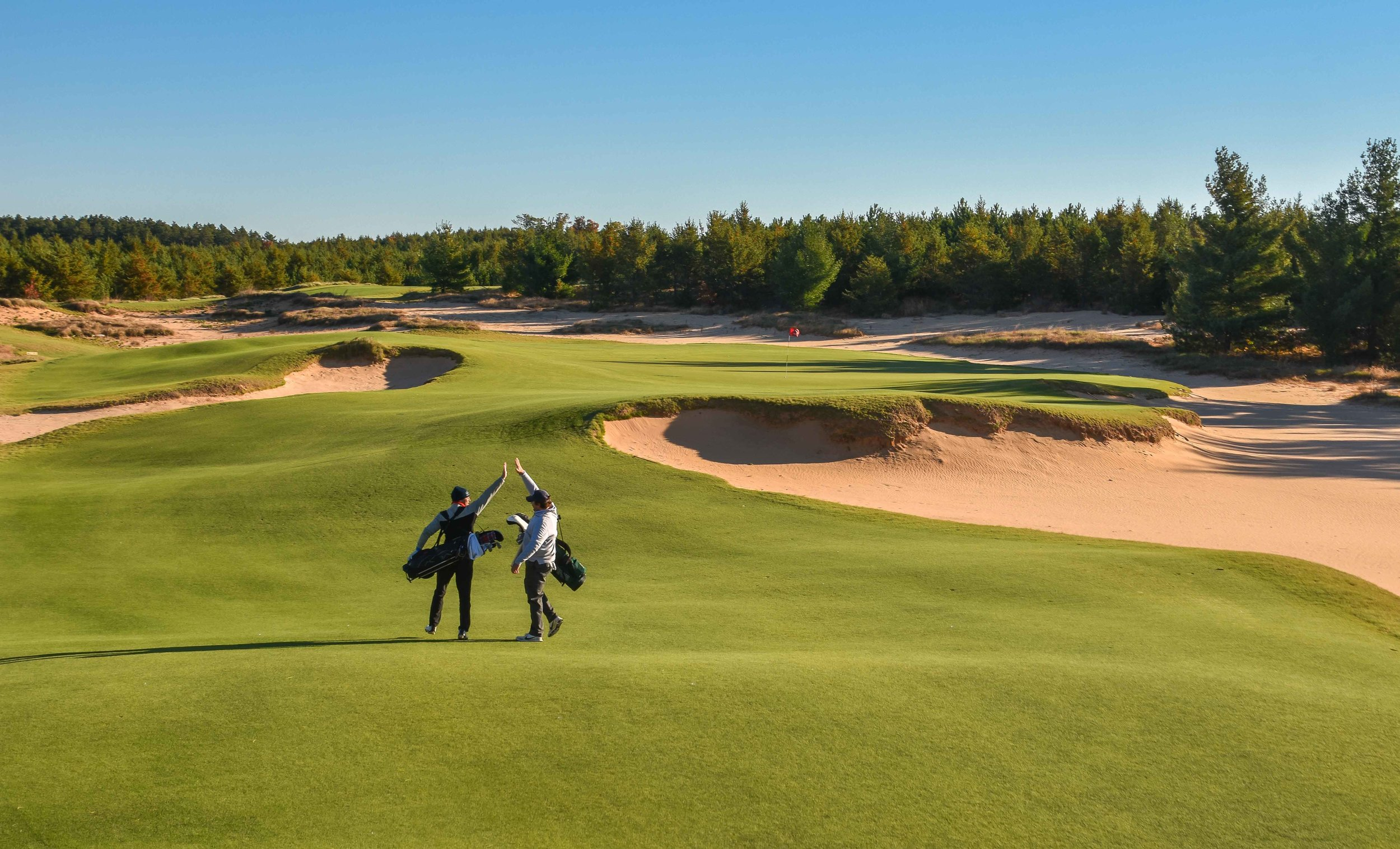 Even when you both miss the green, you still high five at Mammoth Dunes.