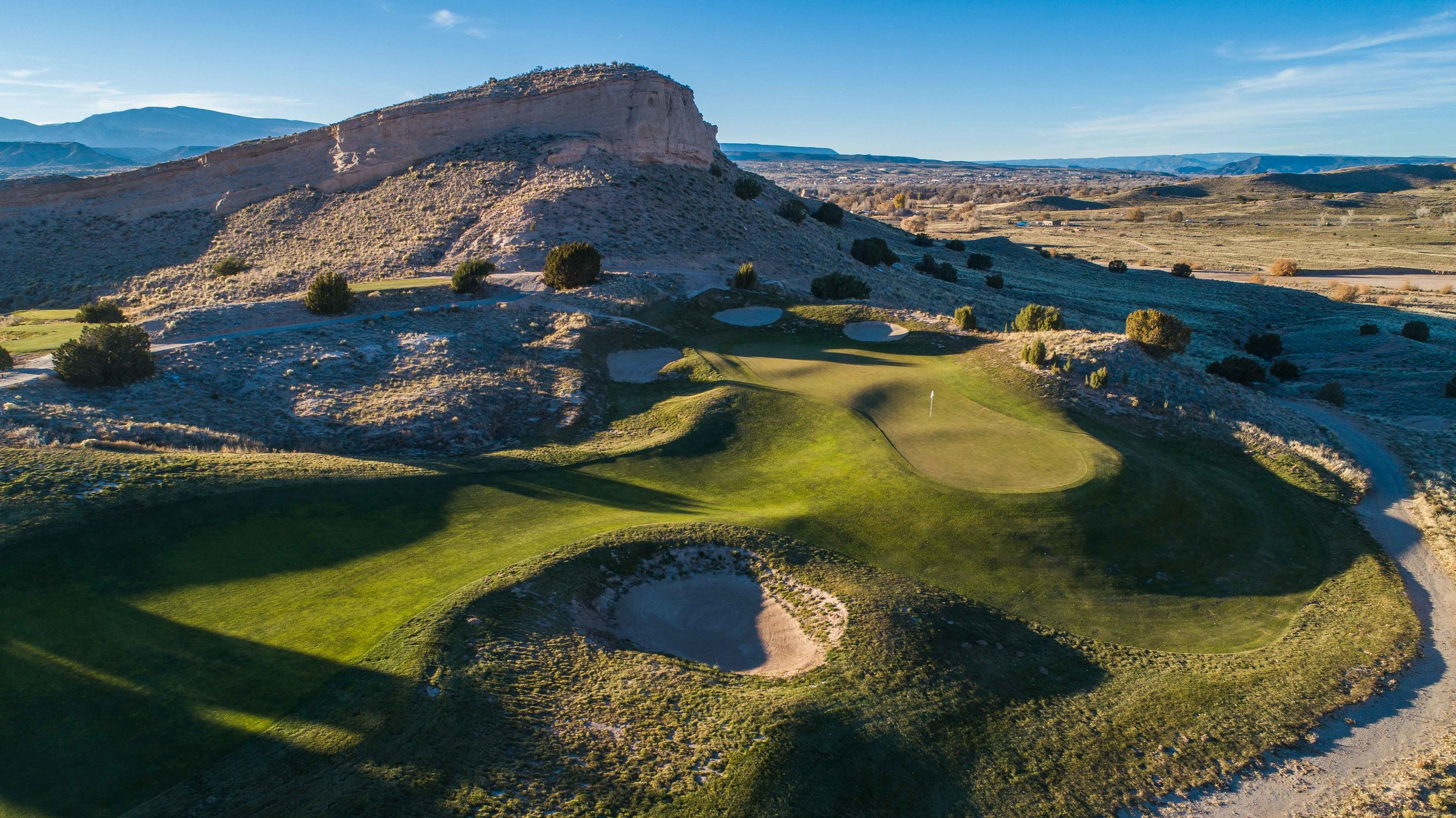 The 7th hole at Black Mesa is a fun short par 4. Just look at that green.