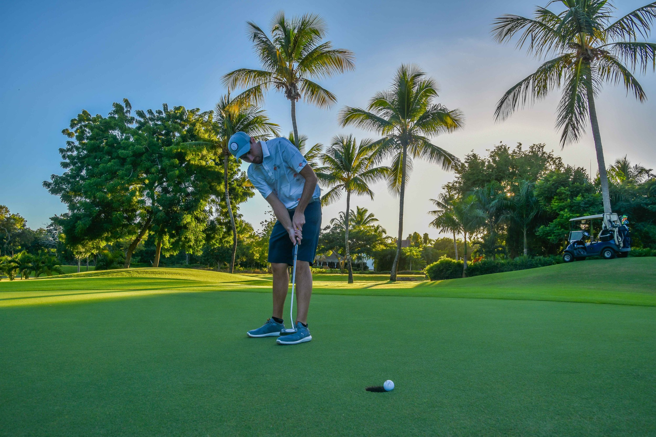 Aspring Golf model Tim Reilly attempts to find the back door on the par 4 14th at La Romana Country Club.