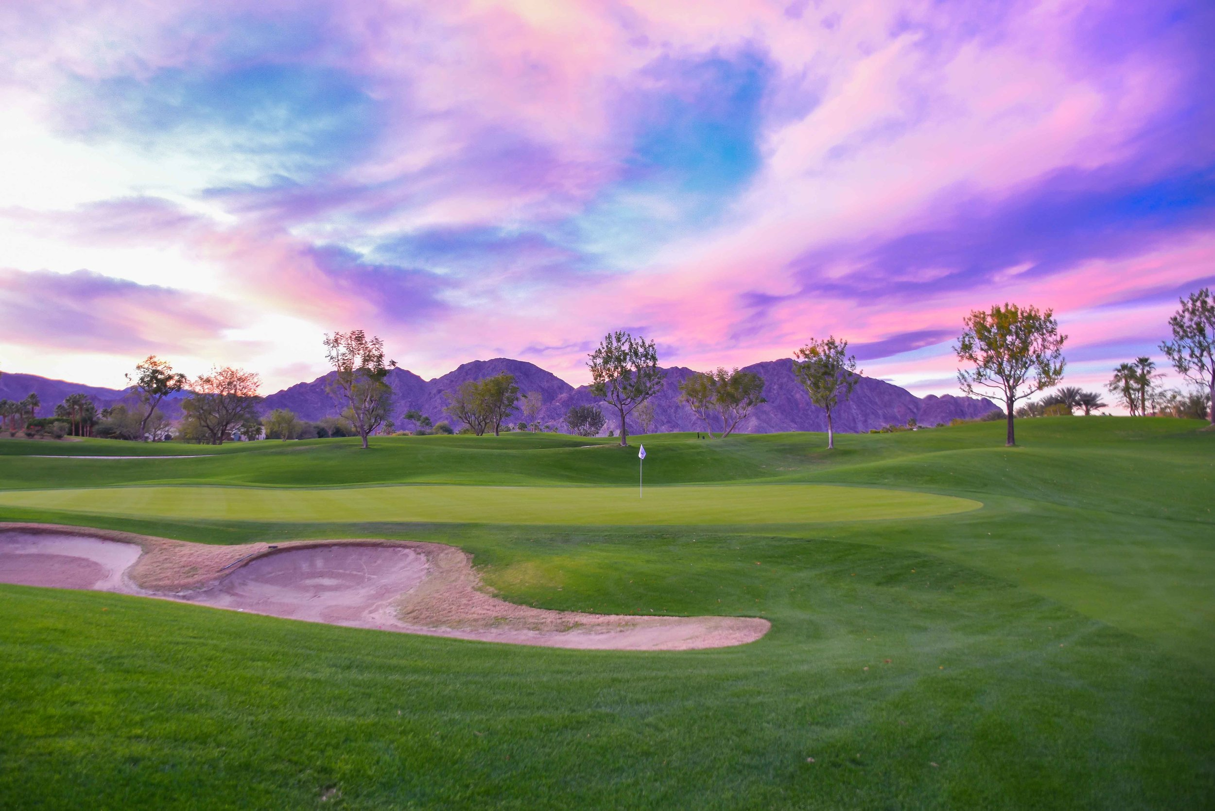 A Palm Springs sunset over the Weiskopf Private Course