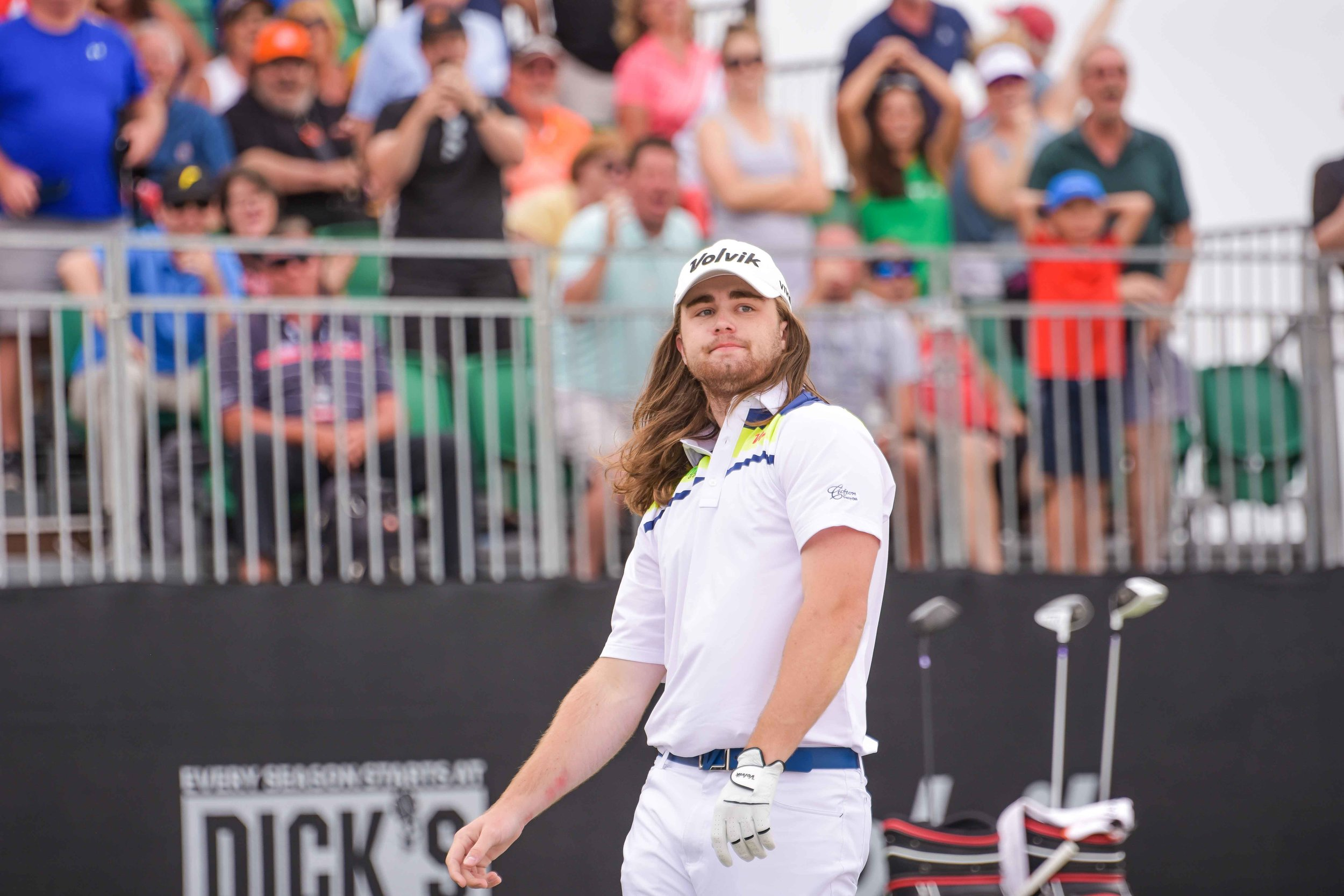 Kyle Berkshire reacts to his final drive of 466 yards coming up 8 yards short of champion Tim Burke.