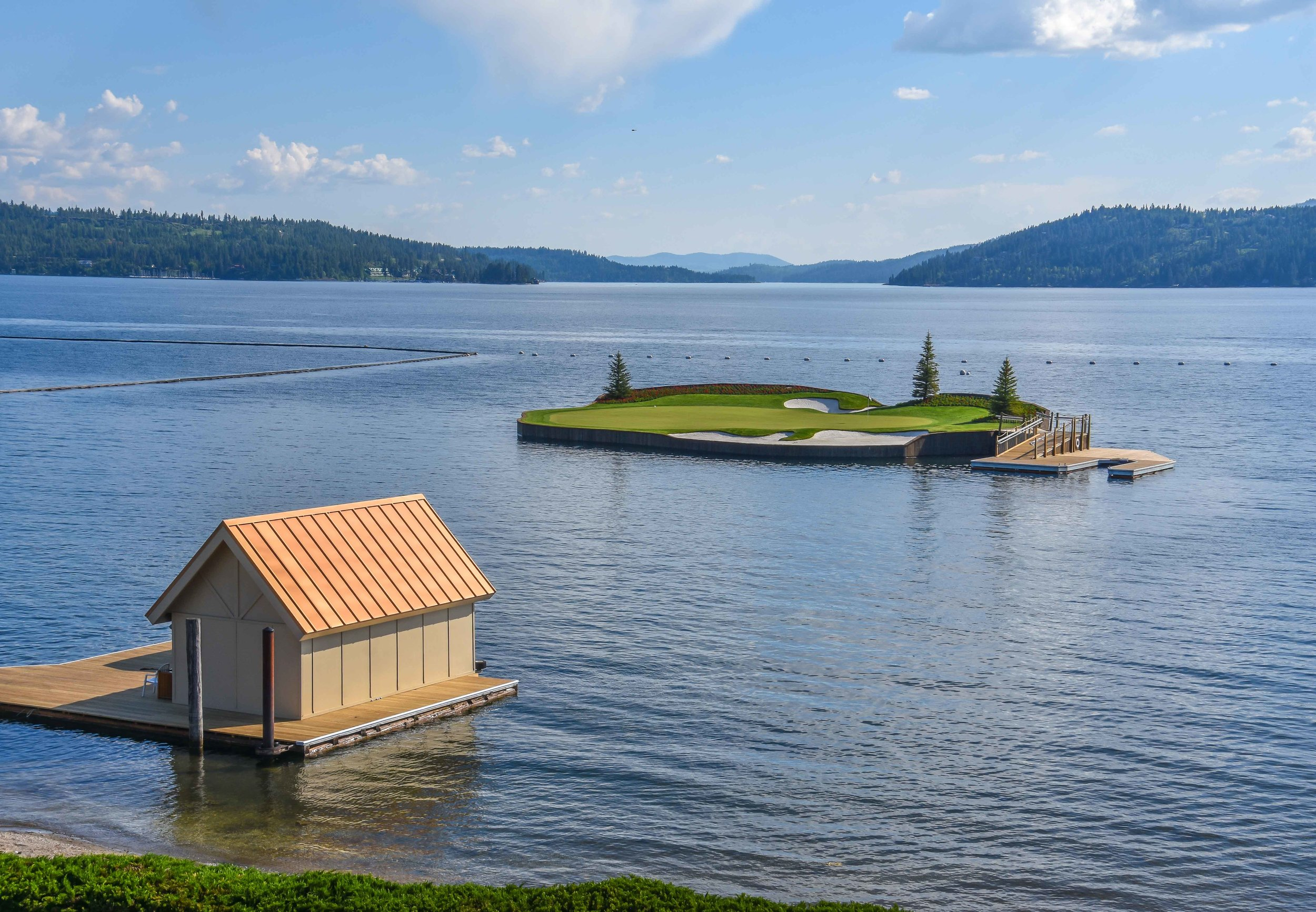 The view of the floating 14th green emerges as soon as you step outside of the clubhouse.